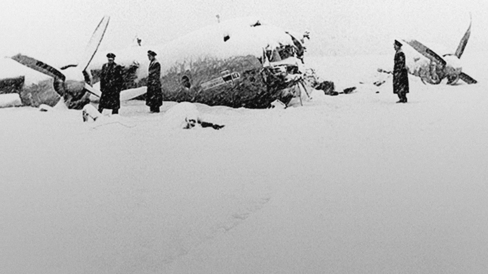 Officials survey the wreckage of Manchester United's plane after the Munich Air Disaster of February 1958.