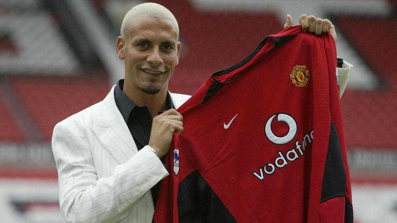 Rio Ferdinand with the shirt.