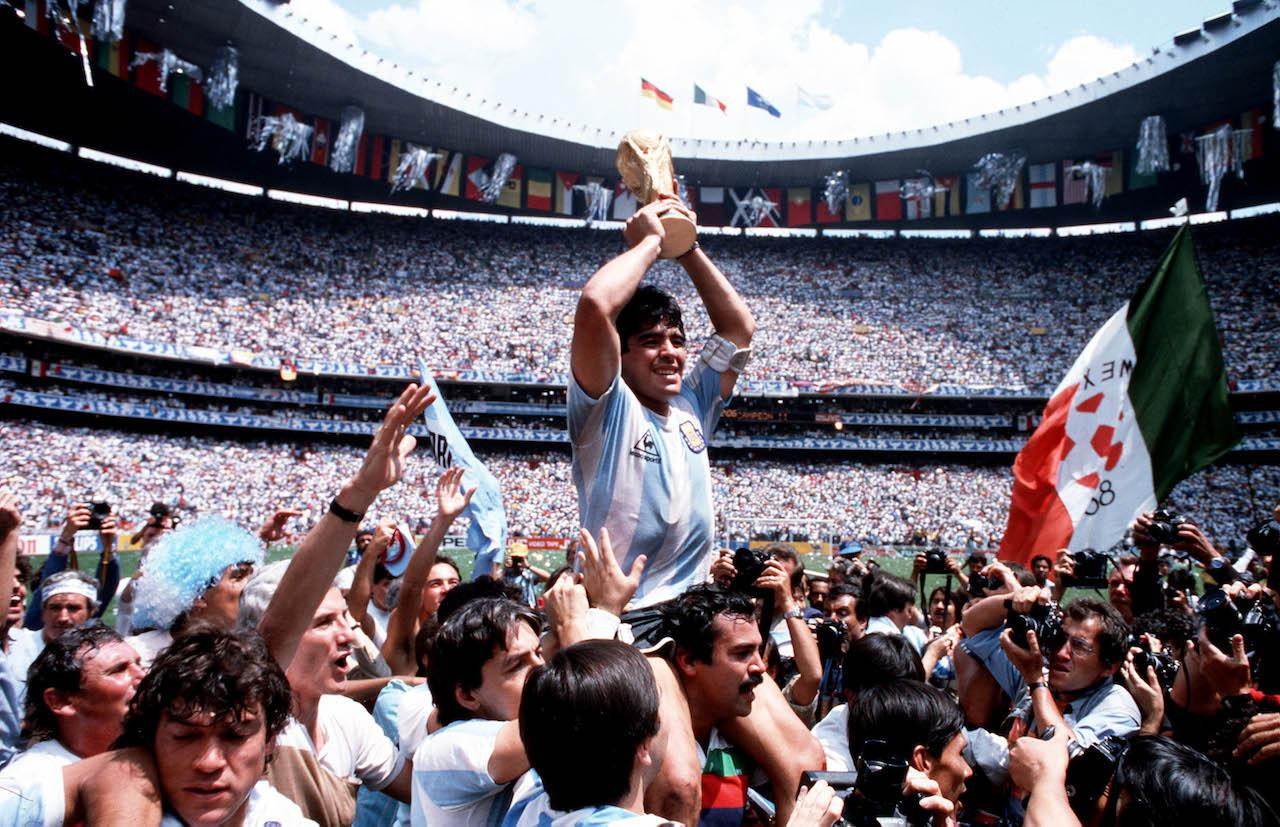 Diego Maradona lifting the World Cup.