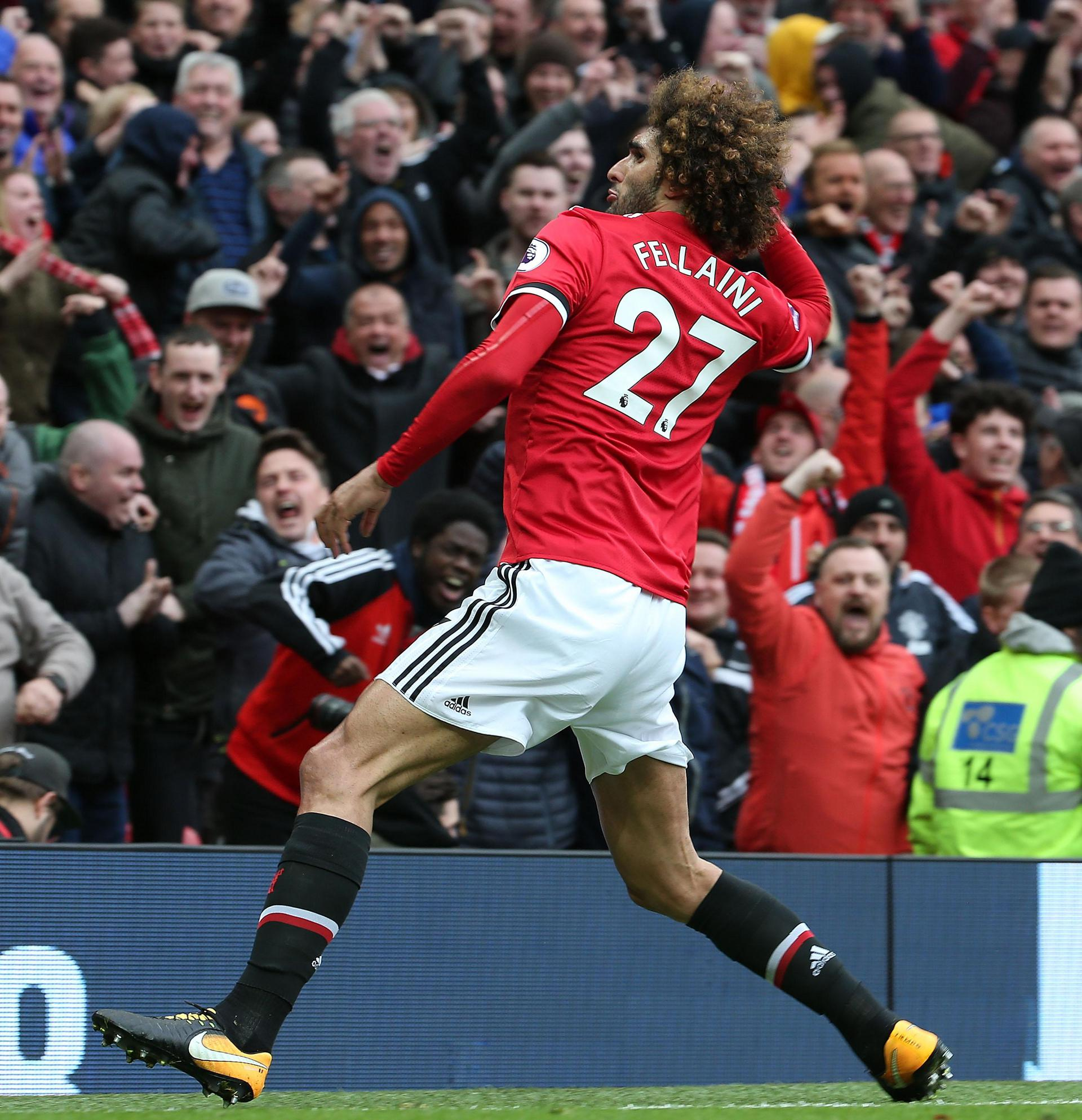 Fellaini celebrating his goal against Arsenal in front of the Stretford End.