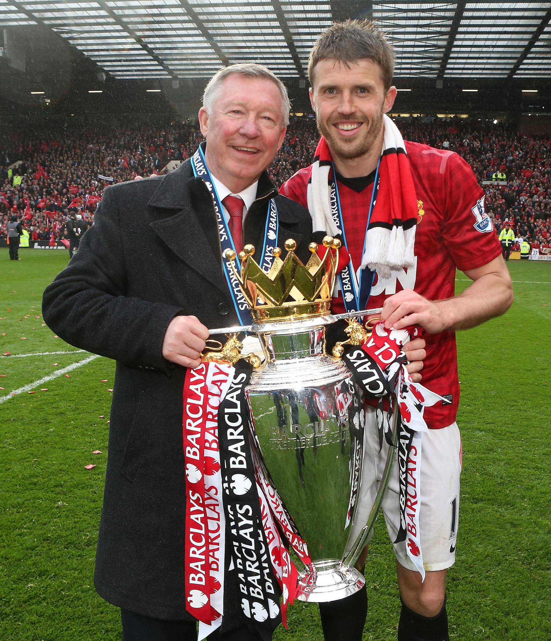 Sir Alex Ferguson y Michael Carrick