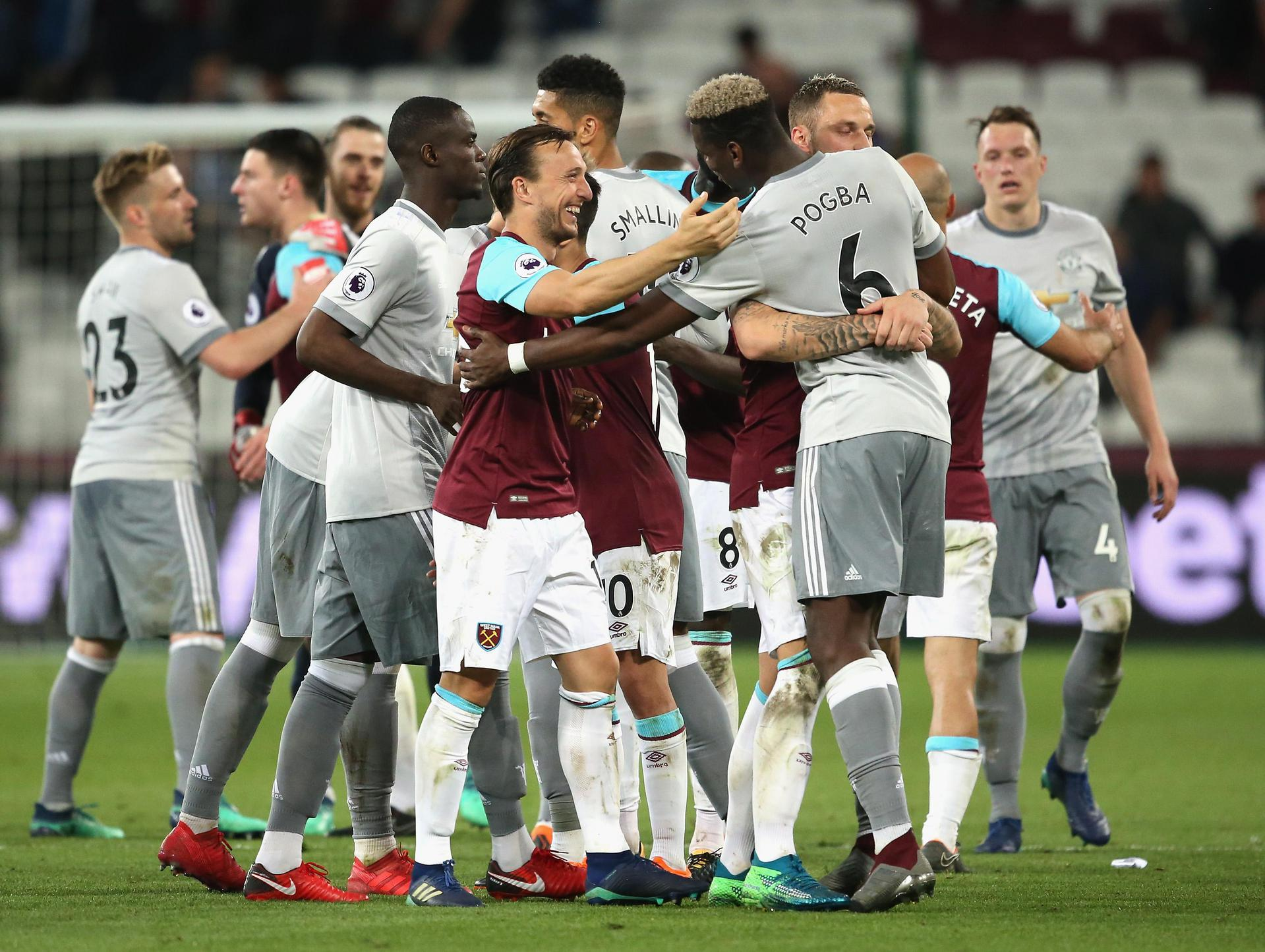 United and West Ham players embrace after the final whistle