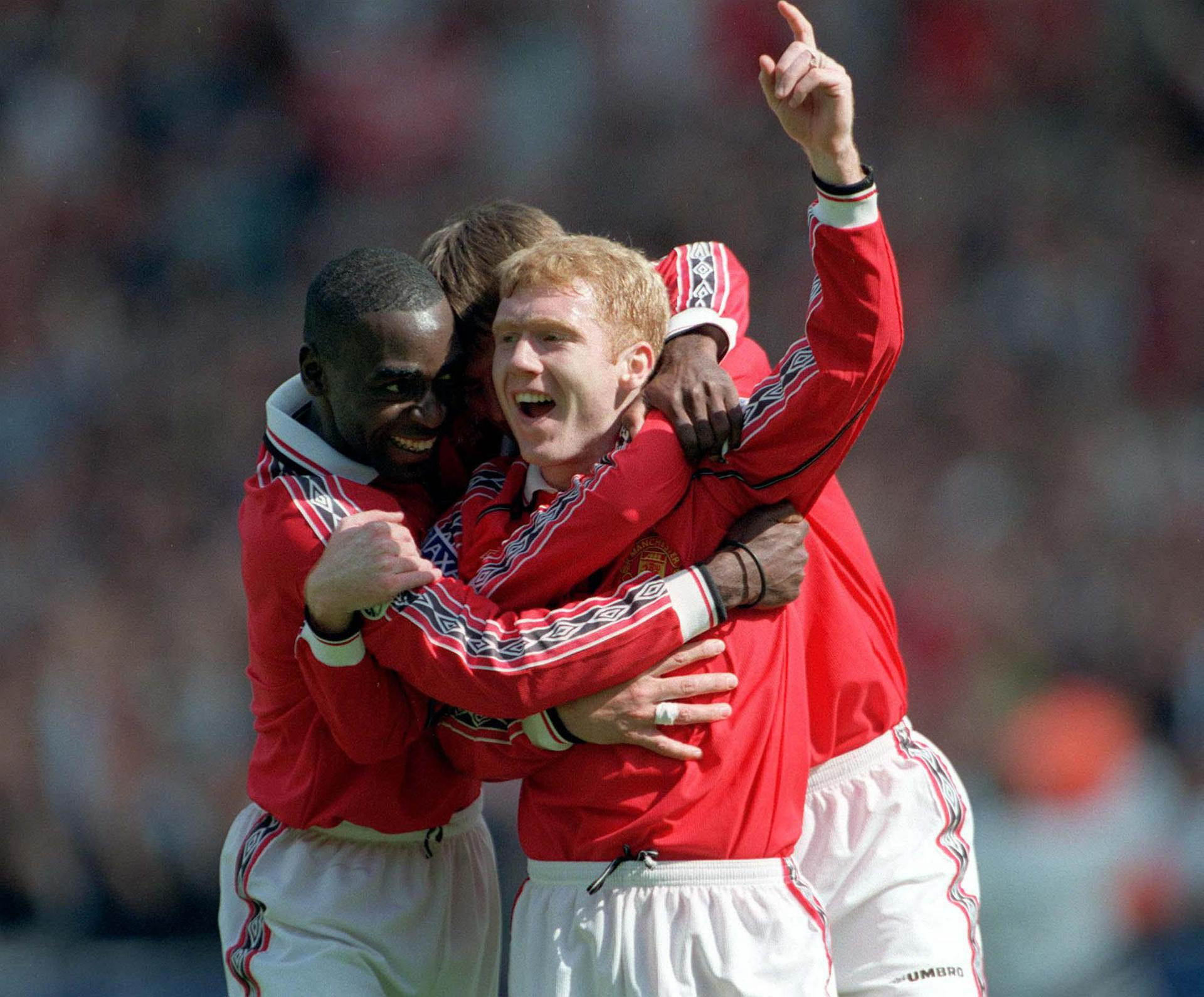 Paul Scholes celebrates scoring for United against Newcastle.