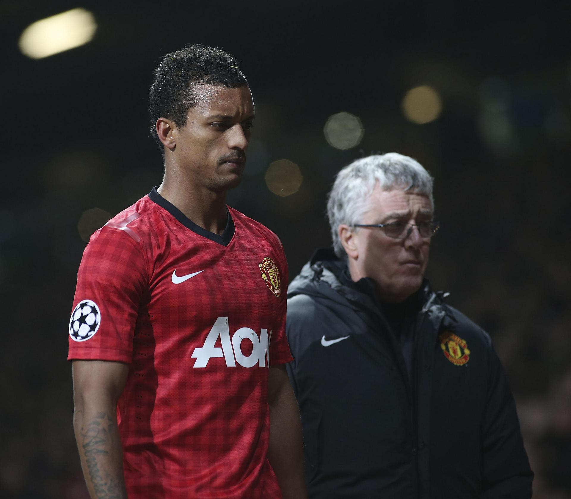 Nani walks off the Old Trafford pitch after being sent off against Real Madrid.