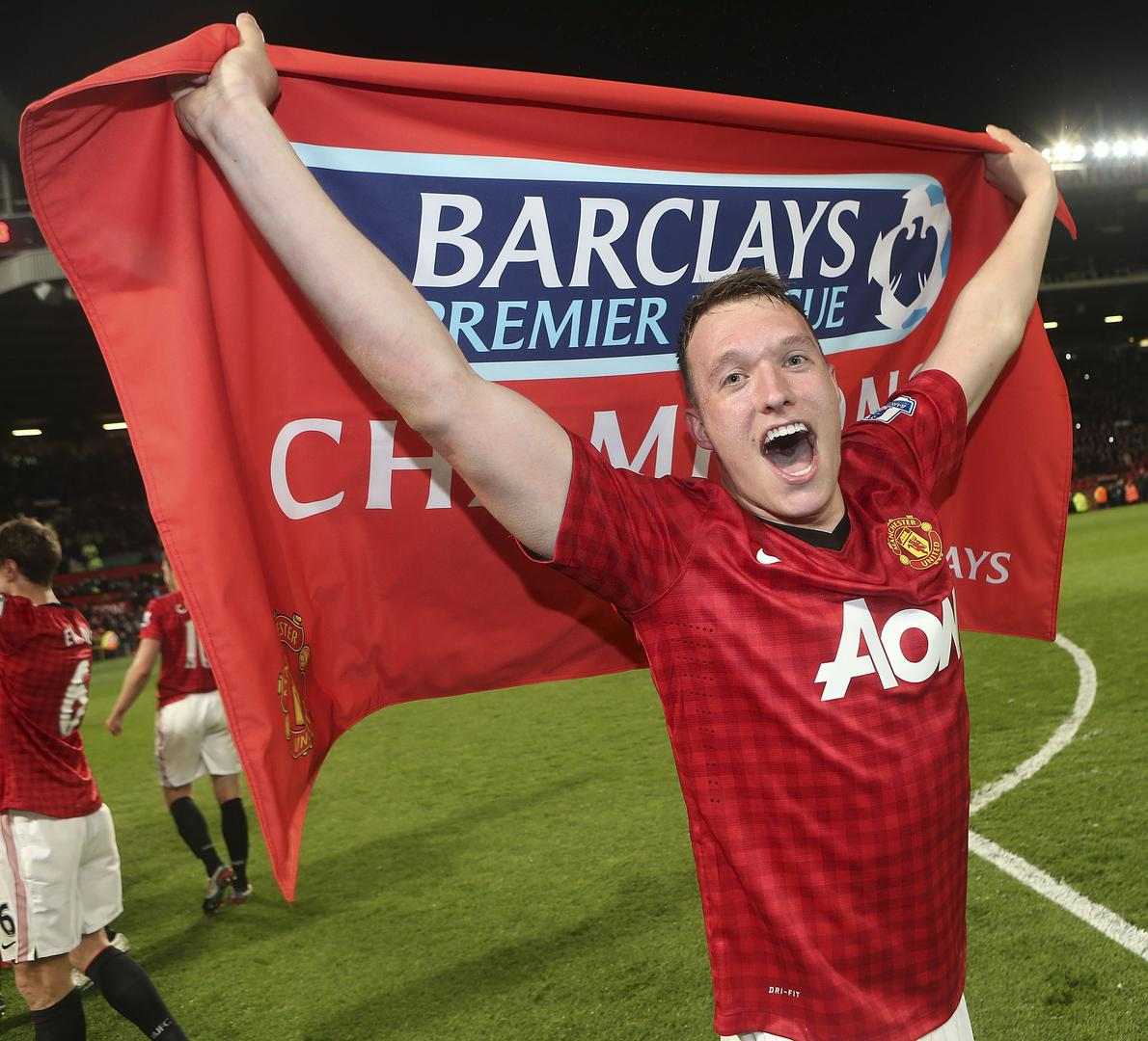Phil Jones celebrates winning the Premier League in 2013