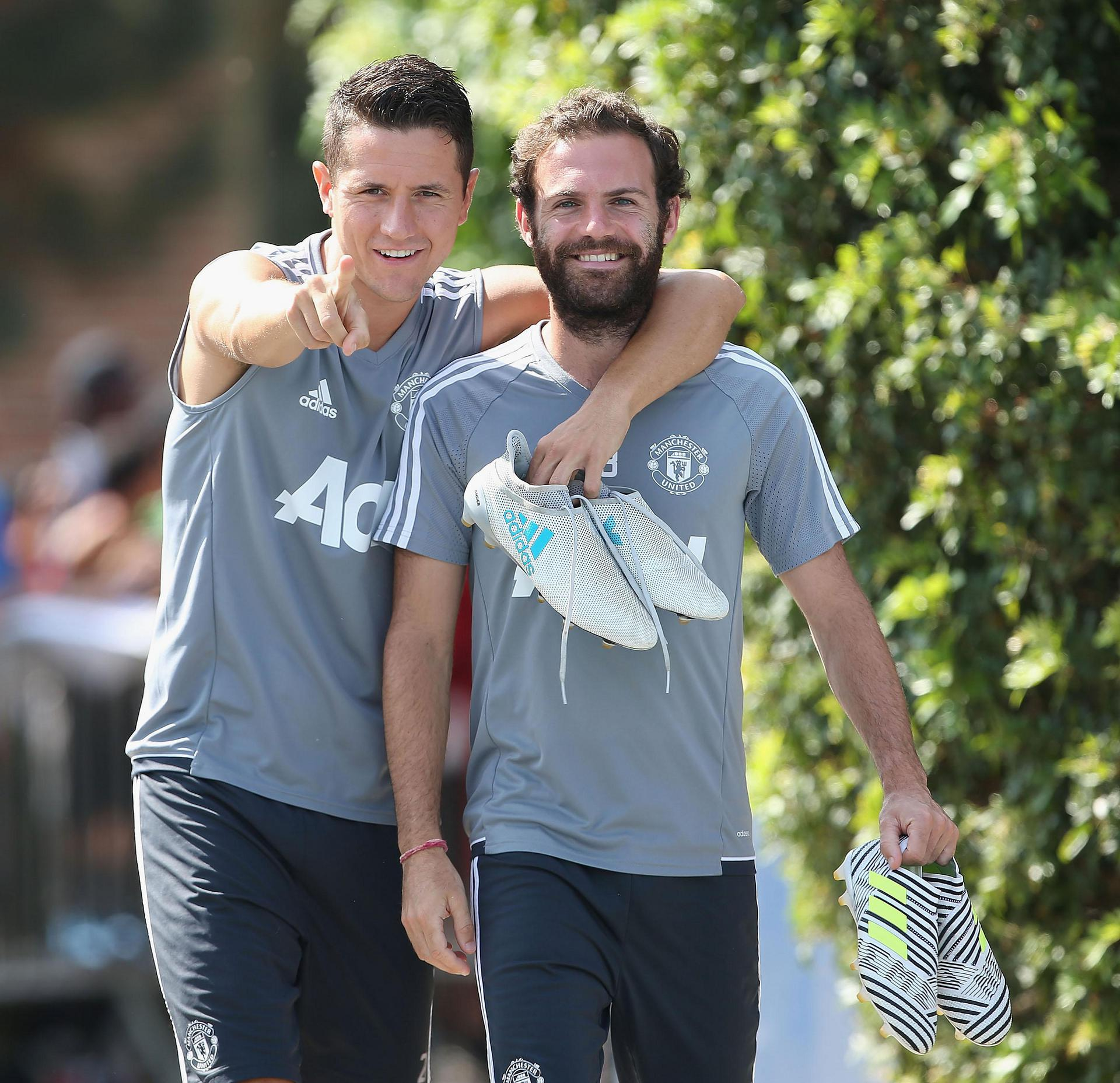 Juan Mata and Ander Herrera pose for the camera during Tour 2017
