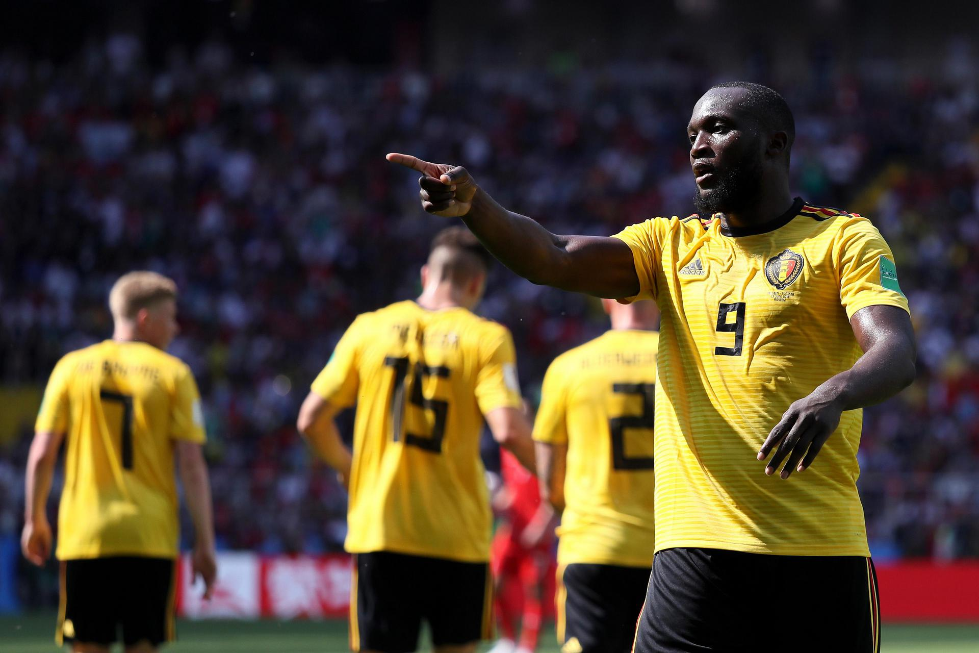 Romelu Lukaku points as he celebrates scoring for Belgium