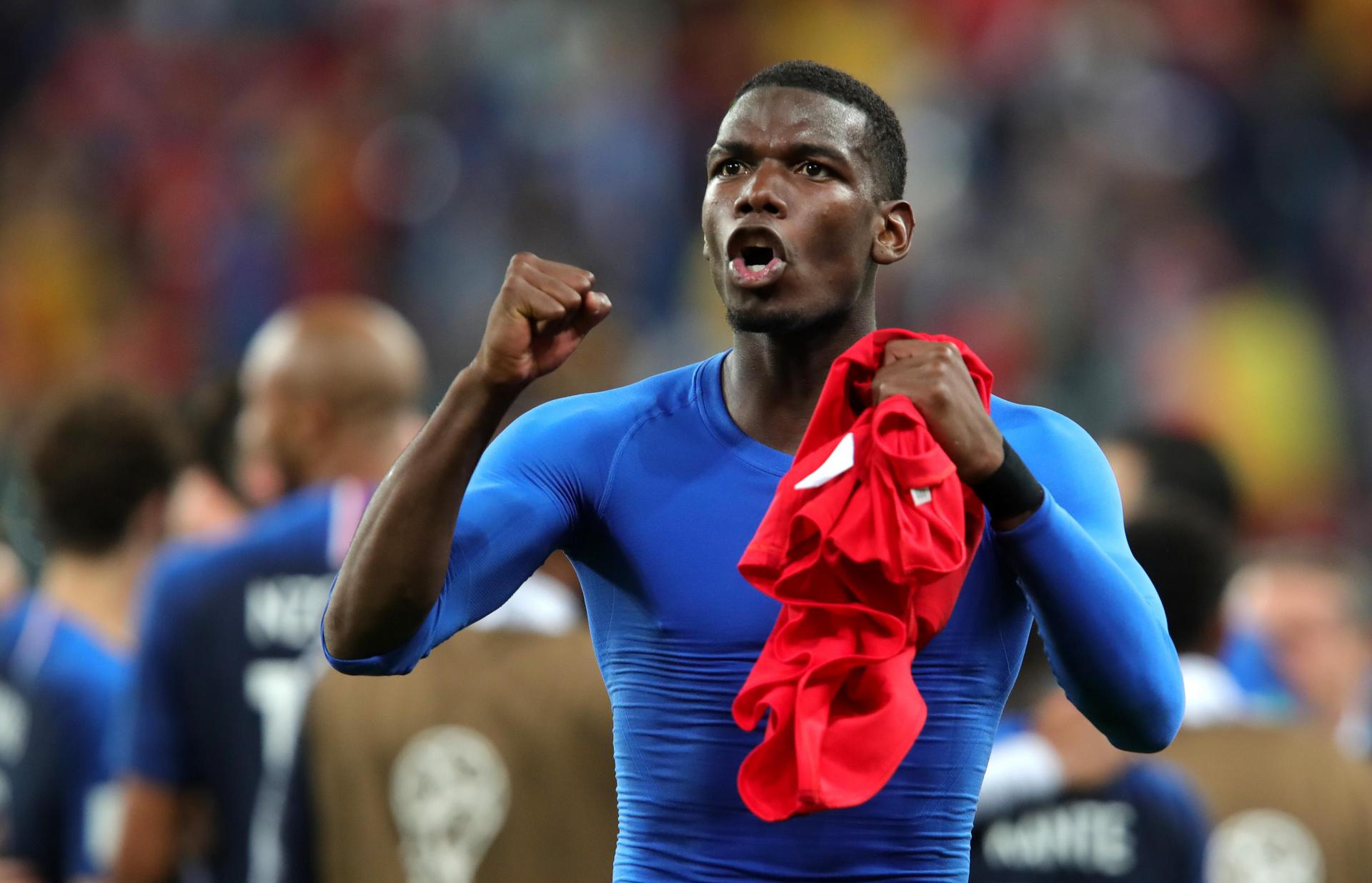 Paul Pogba celebrates after France reach the World Cup final.
