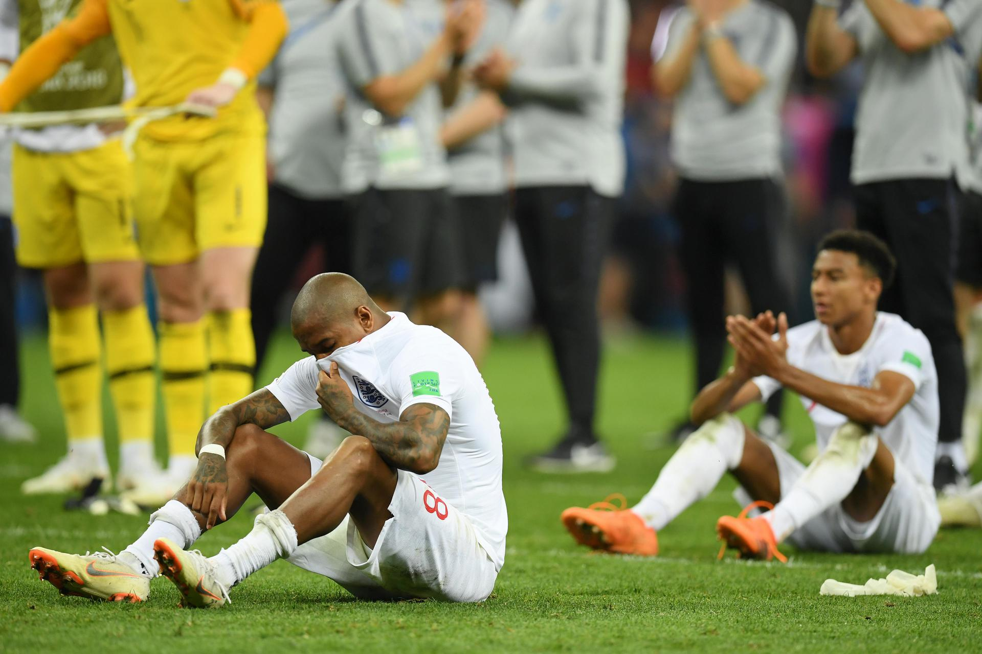 Ashley Young and Jesse Lingard look dejected after England's defeat