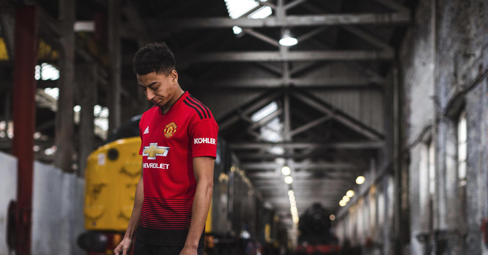 Jesse Lingard models the new United home shirt for 2018/19