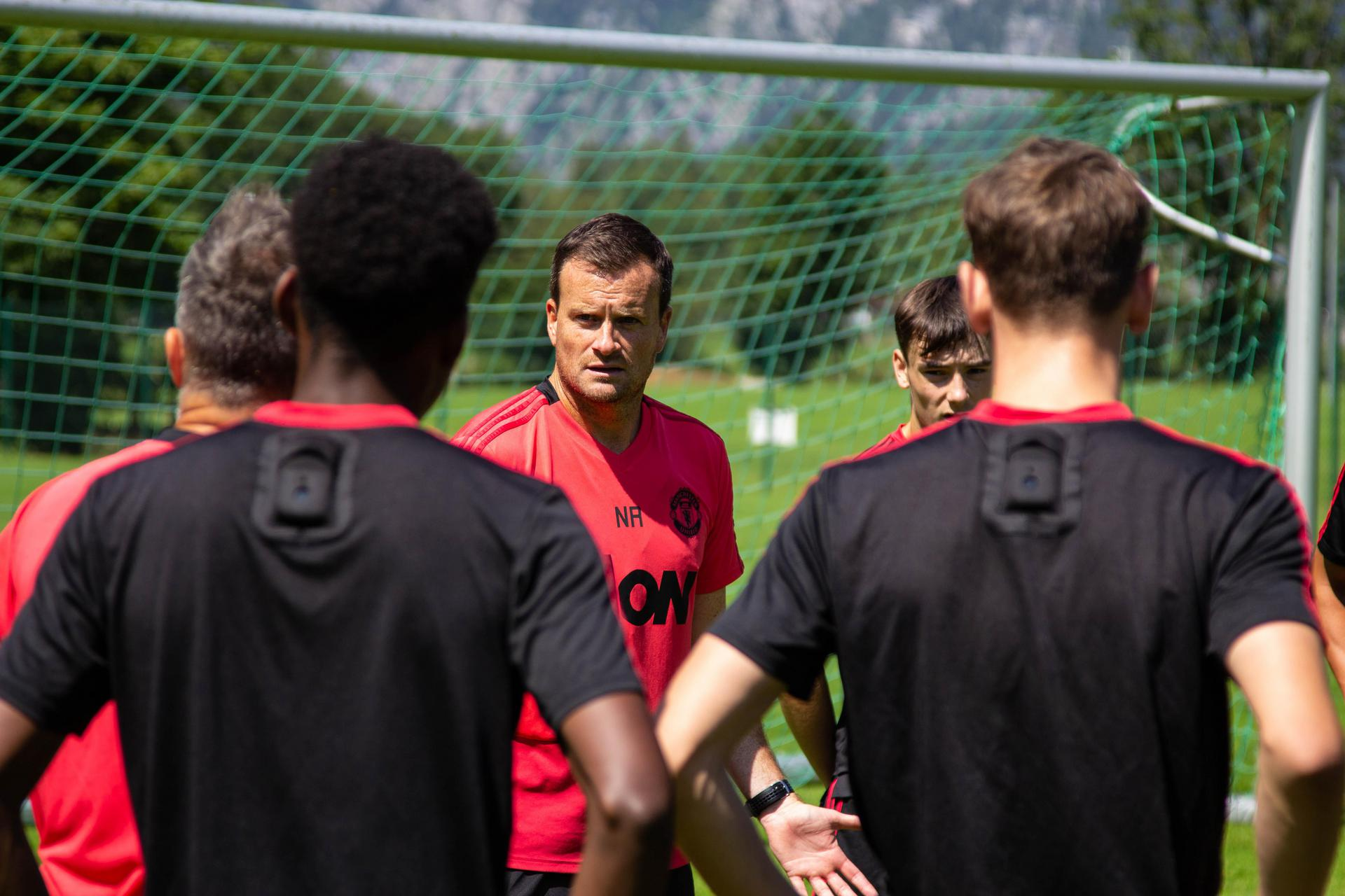 Neil Ryan talks to his squad in Austria.