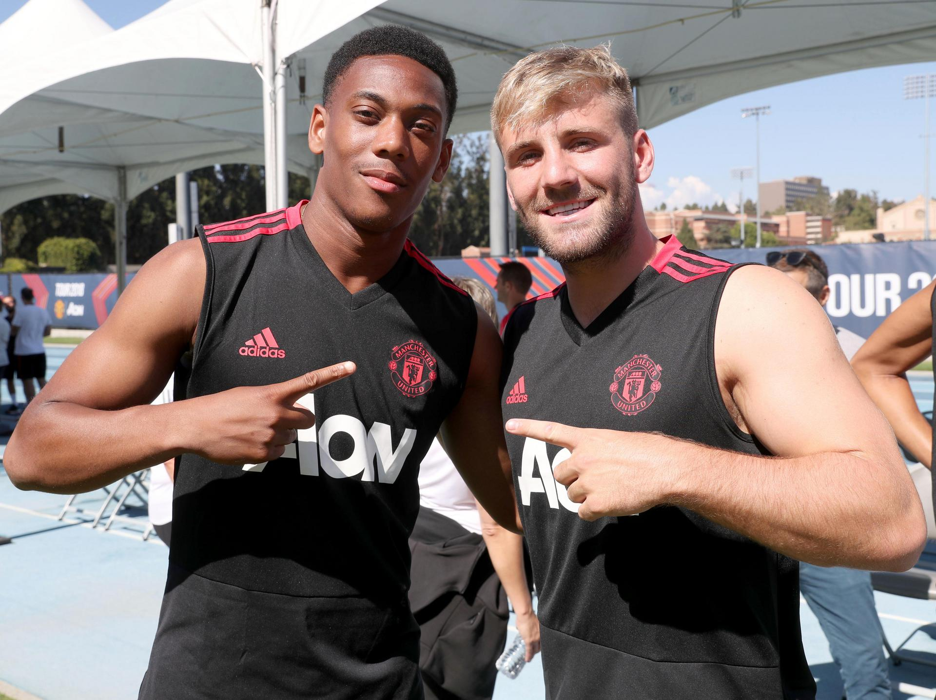 Luke Shaw with Anthony Martial.