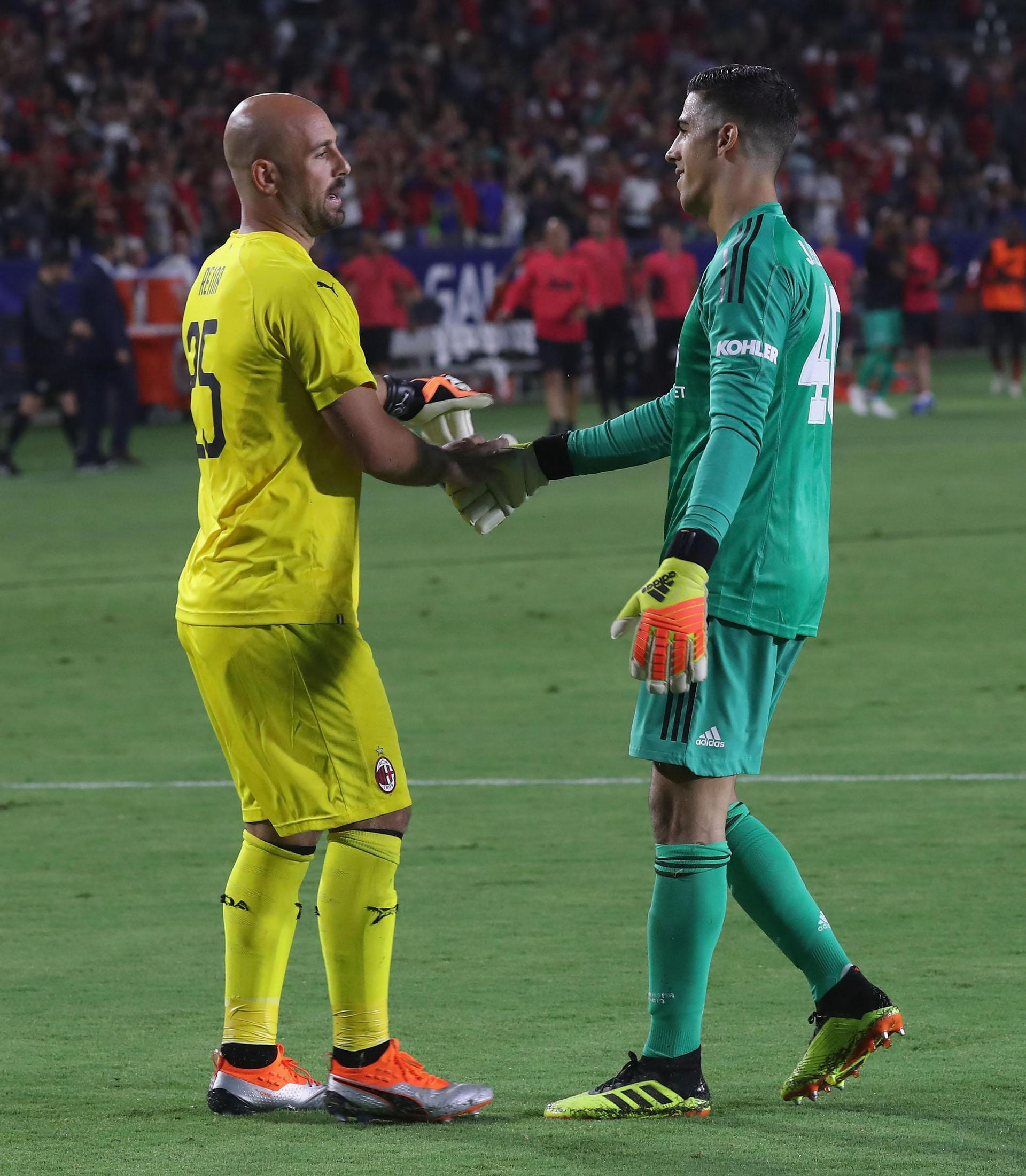 Joel Pereira shakes hands with Pepe Reina after United's penalty shootout win over AC Milan