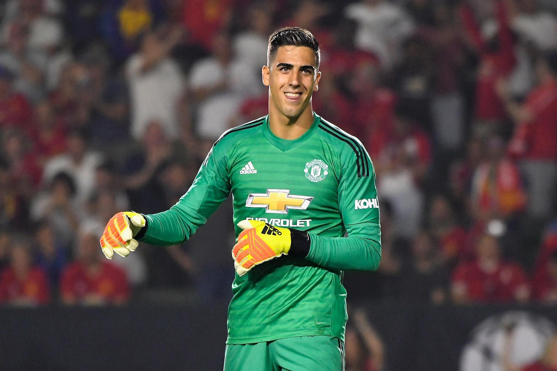 Joel Pereira is happy after helping United beat AC Milan.