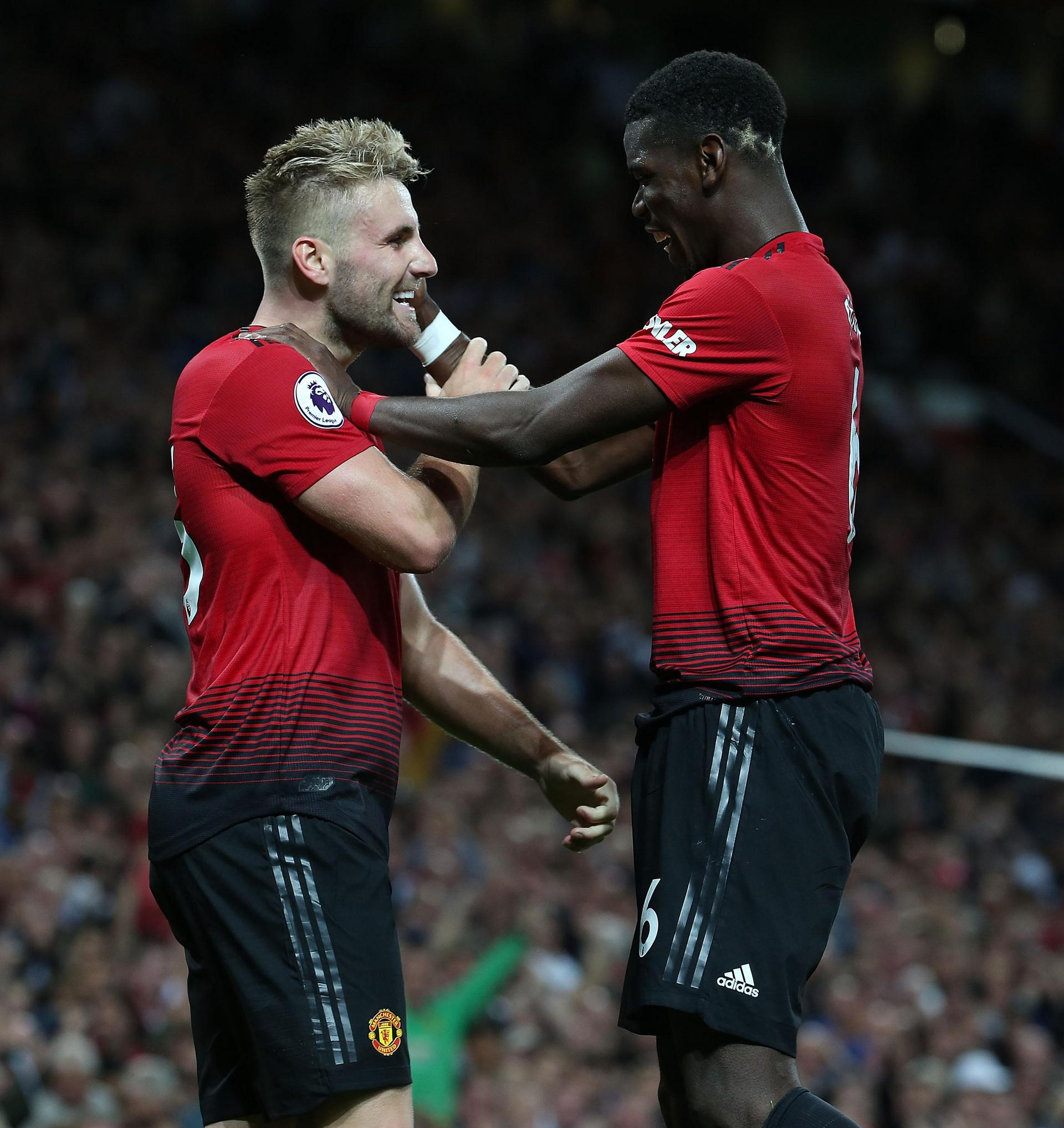Luke Shaw and Paul Pogba at Old Trafford.