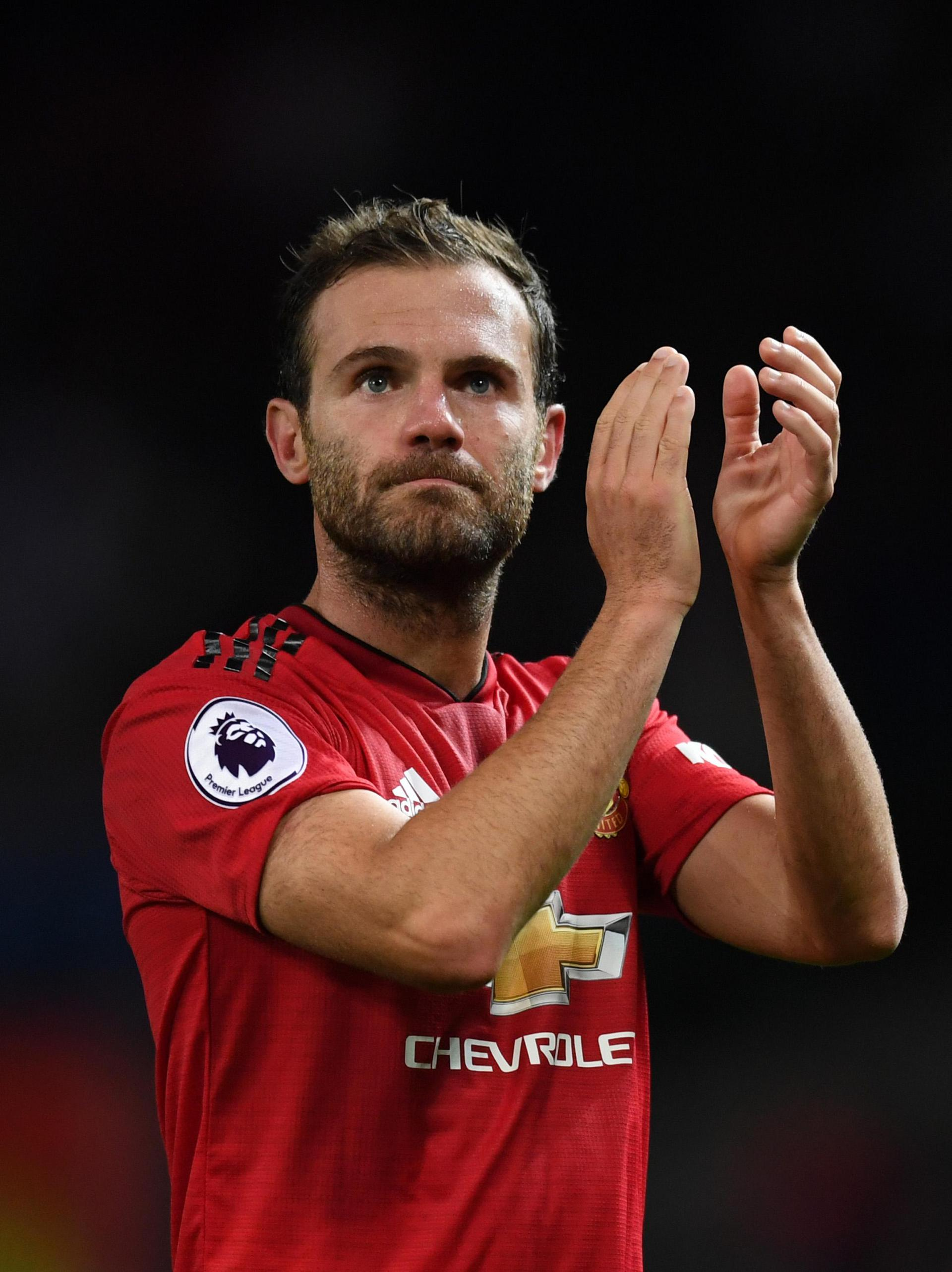 Juan Mata applauds United fans.