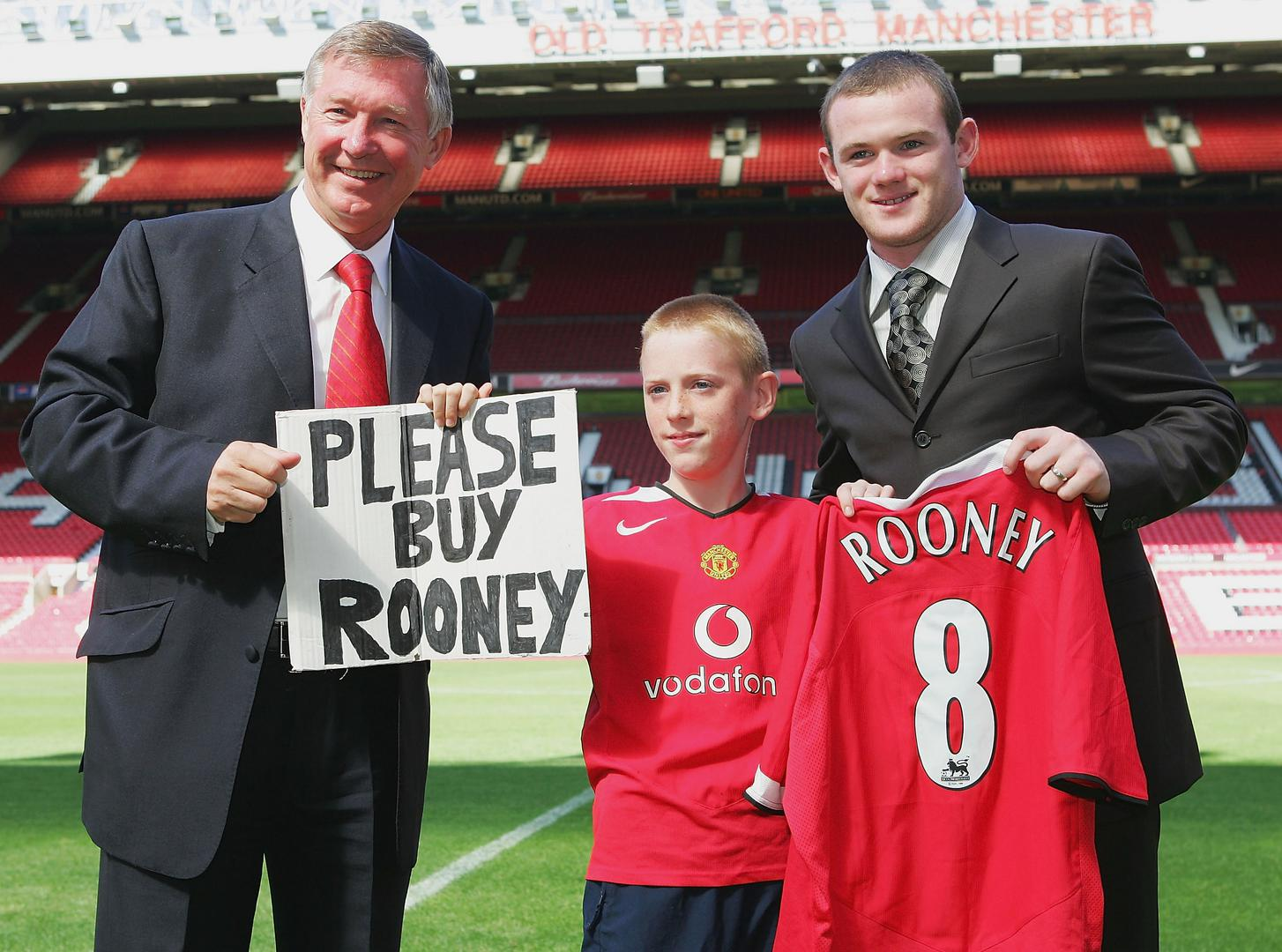 Sir Alex and Wayne Rooney with the young fan who made a sign begging to buy the striker.