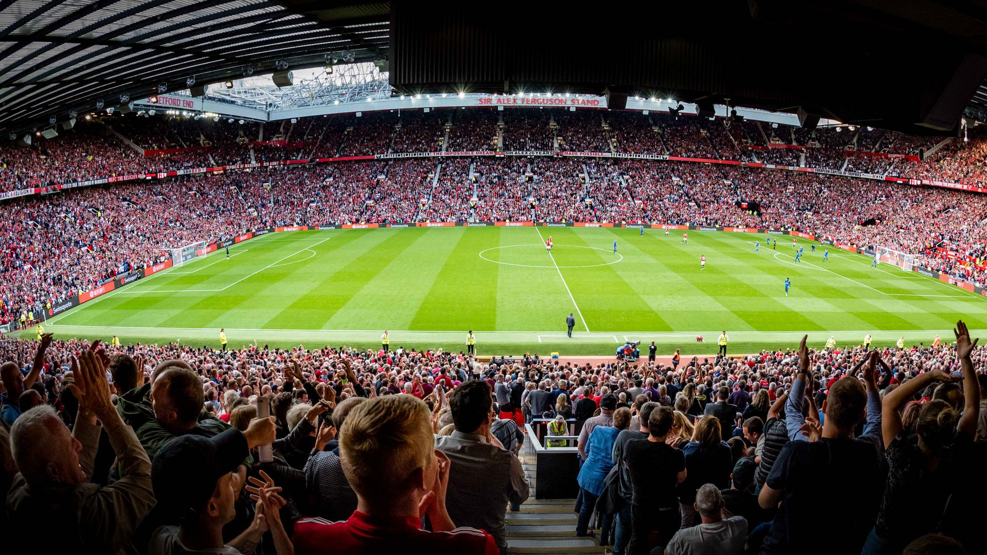 United fans chanting during a match at Old Trafford.,