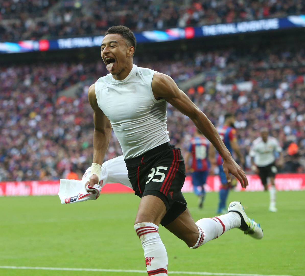Jesse Lingard celebrates scoring the winner in the 2016 FA Cup final