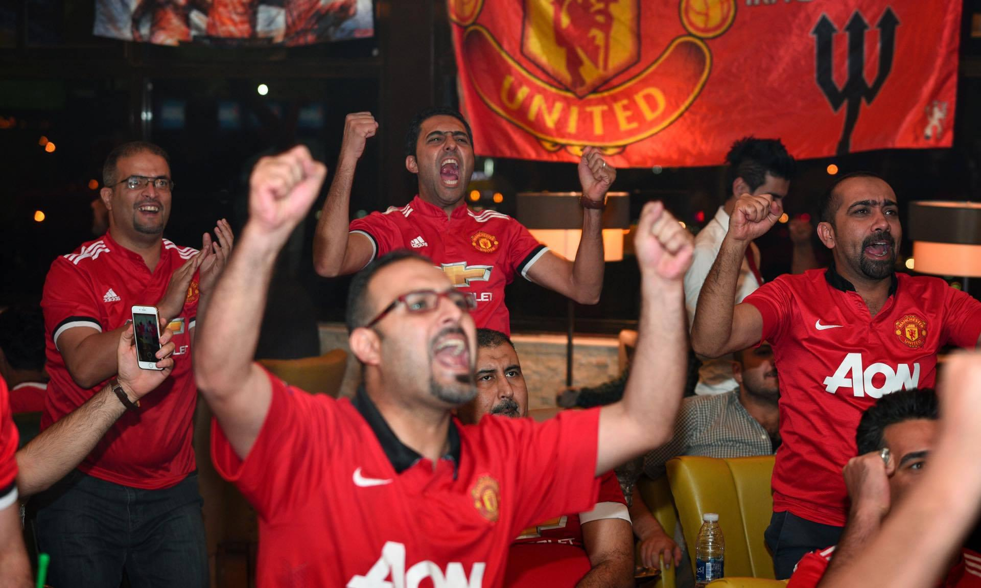 Members of United's supporters' club in Iraq celebrate a goal