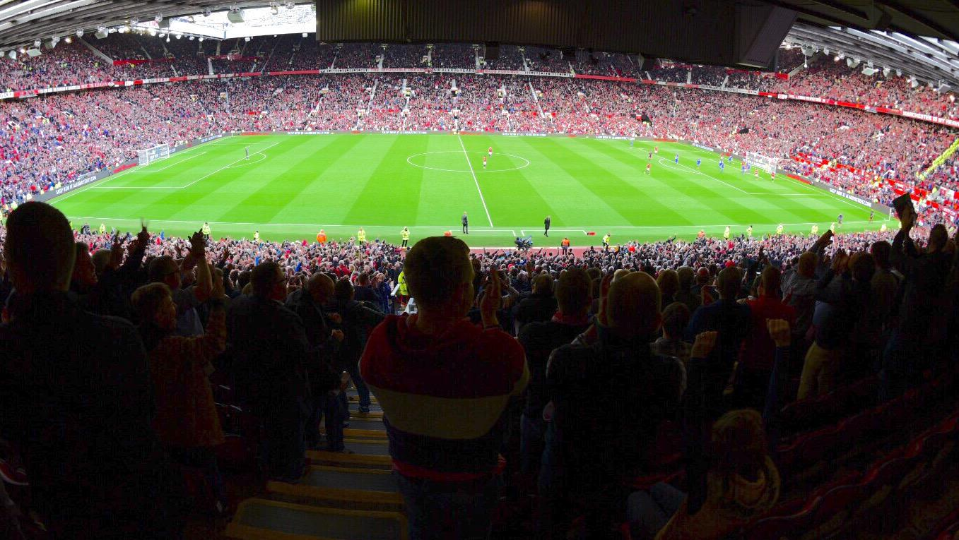 View of the Old Trafford pitch from insi,de the crowd on a matchday