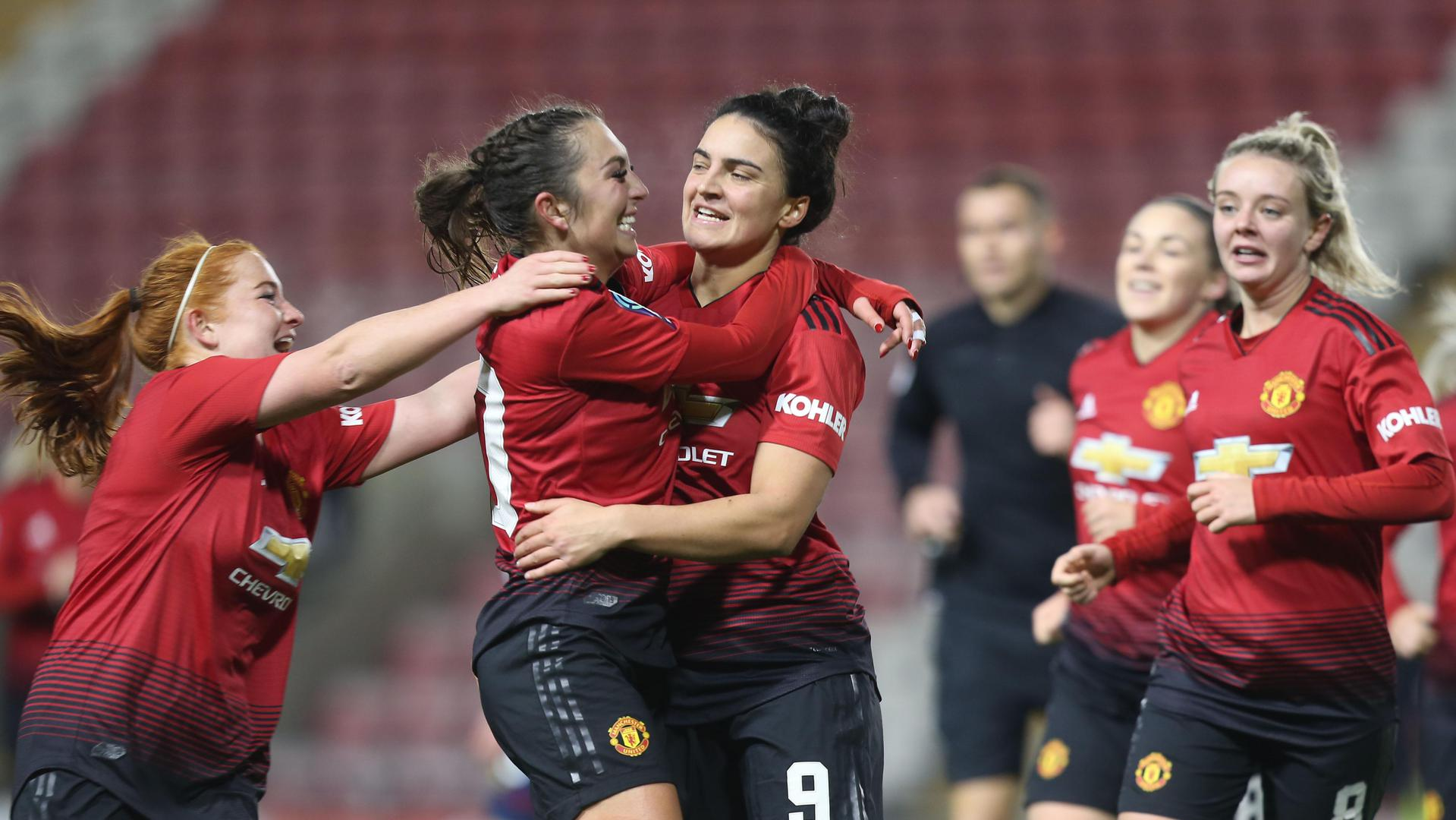 Katie Zelem congratulates Jess Sigsworth on scoring MU Women's second goal against West Ham