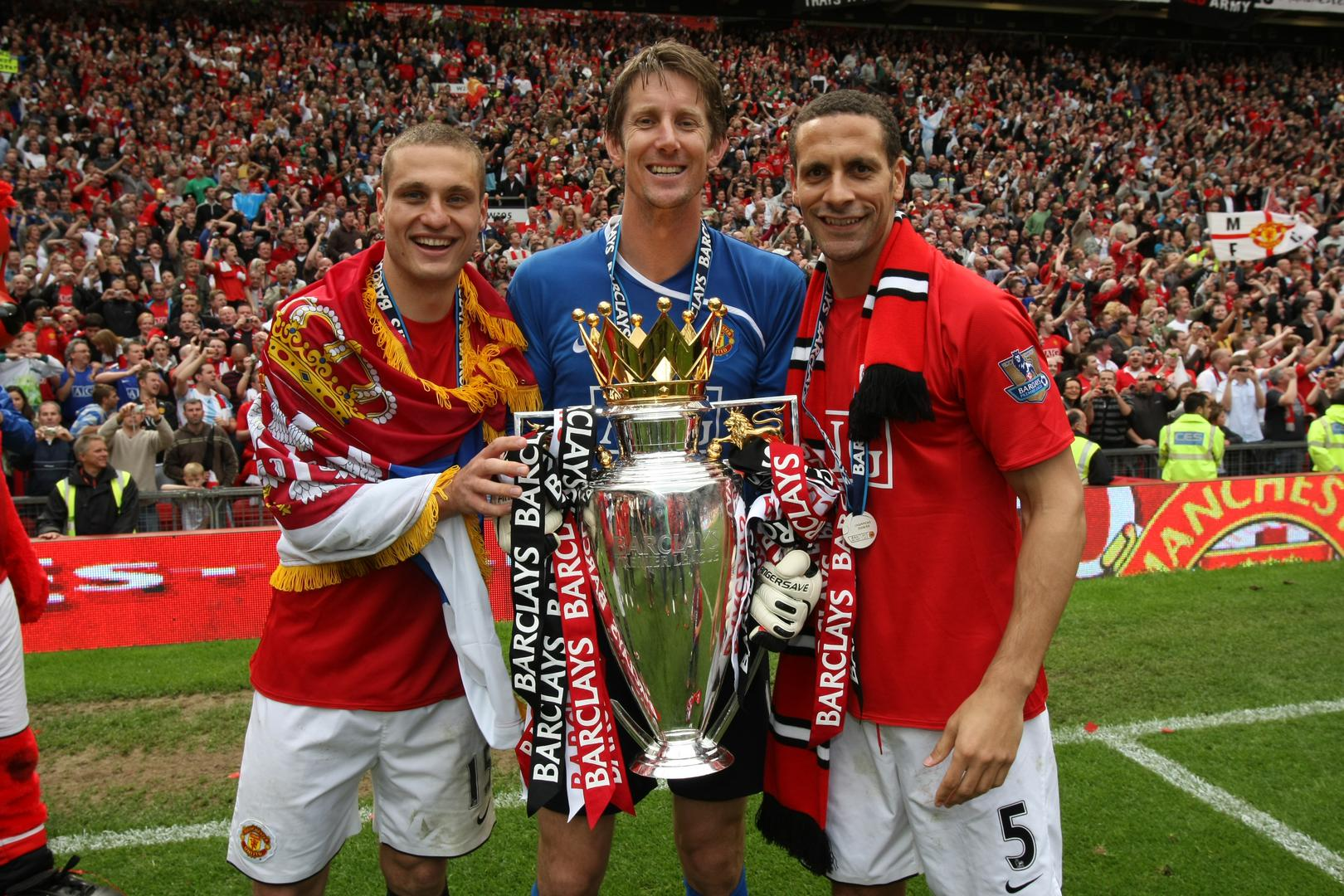 Nemanja Vidic, Edwin van der Sar and Rio Ferdinand with the Premier League trophy in May 2009.