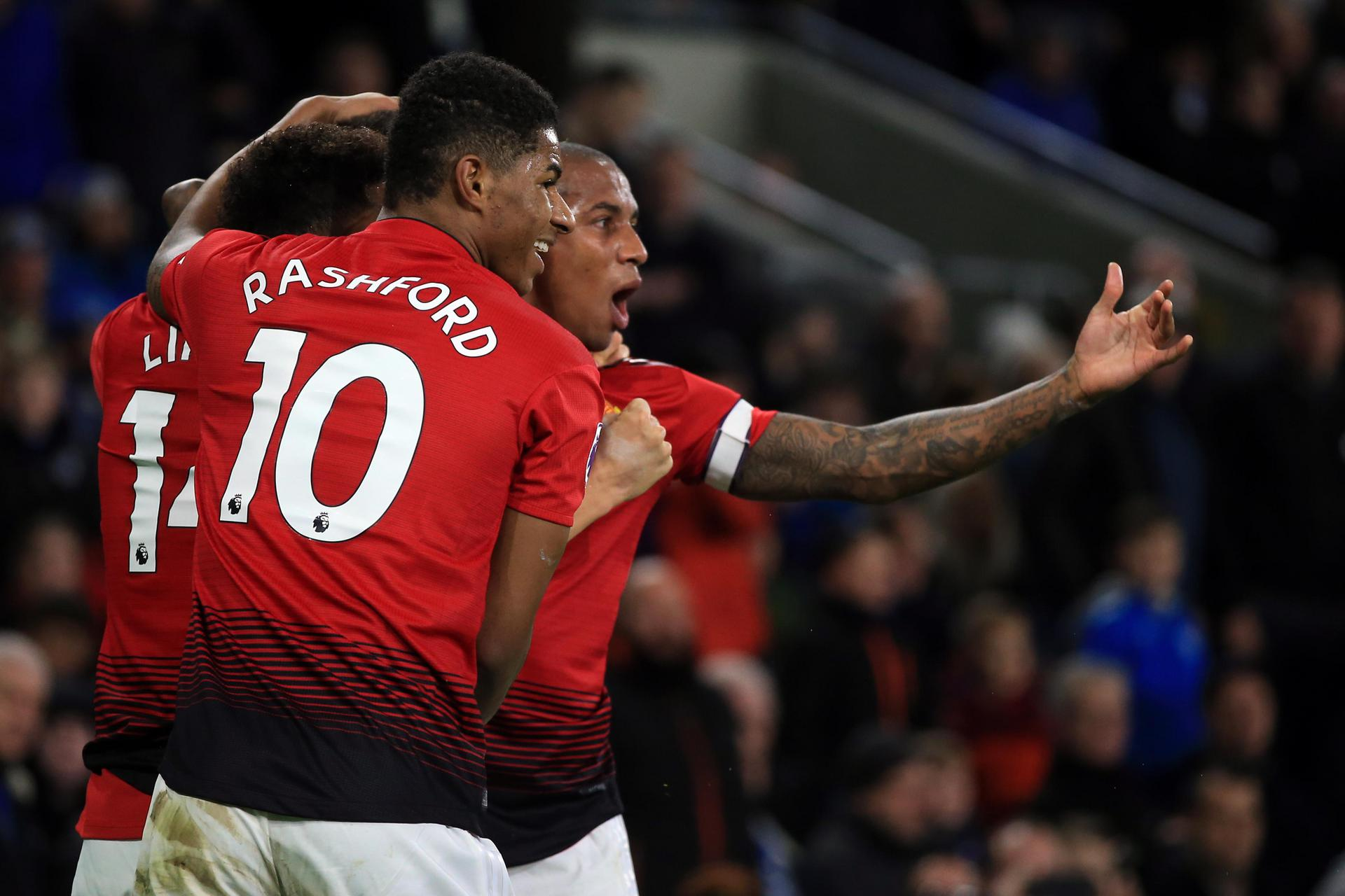 Marcus Rashford celebrates with Ashley Young after scoring against Cardiff