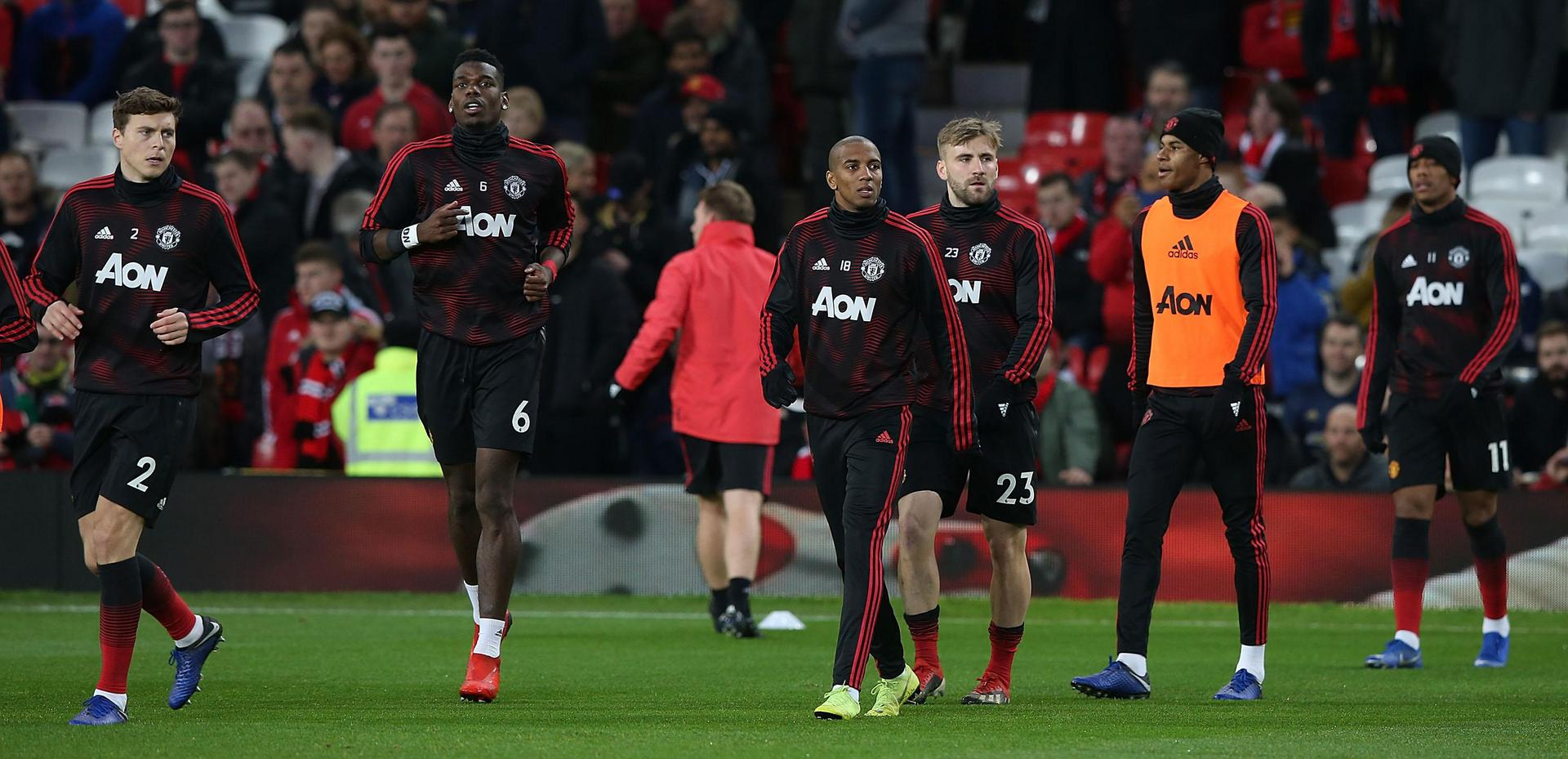 Manchester United players warm up before a match