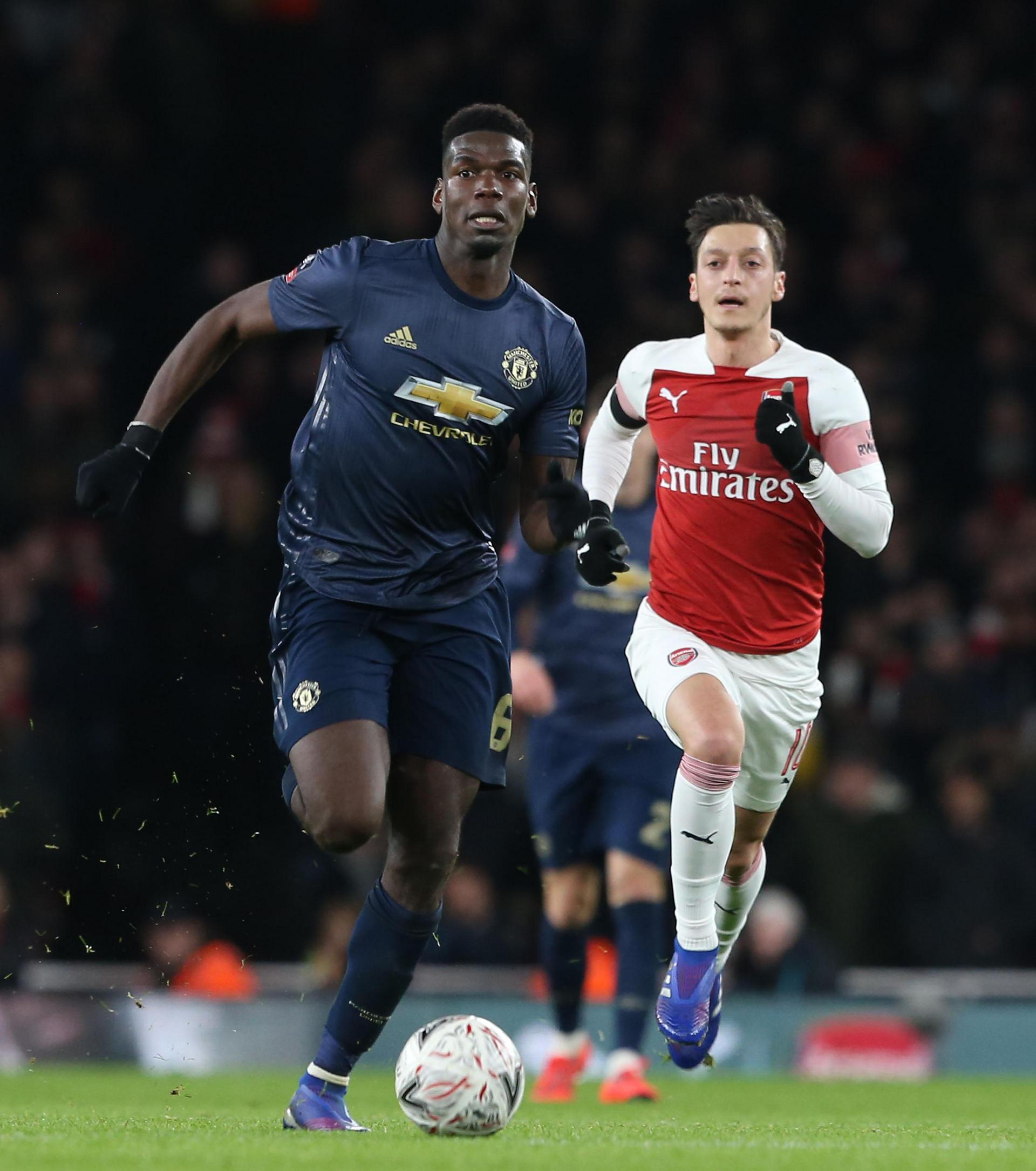 Paul Pogba in action against Arsenal's Mesut Ozil