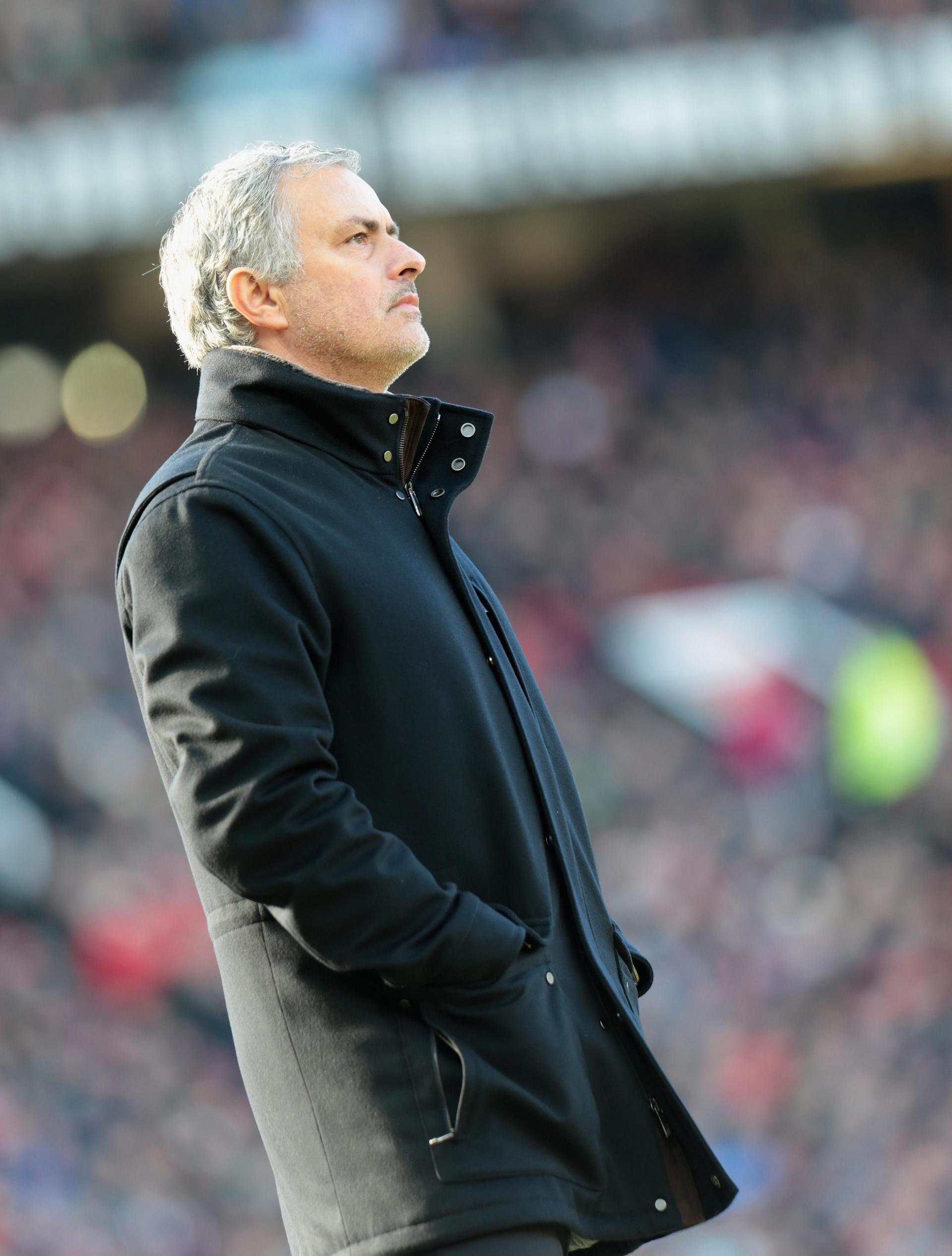 Jose Mourinho looks towards the stand during a match