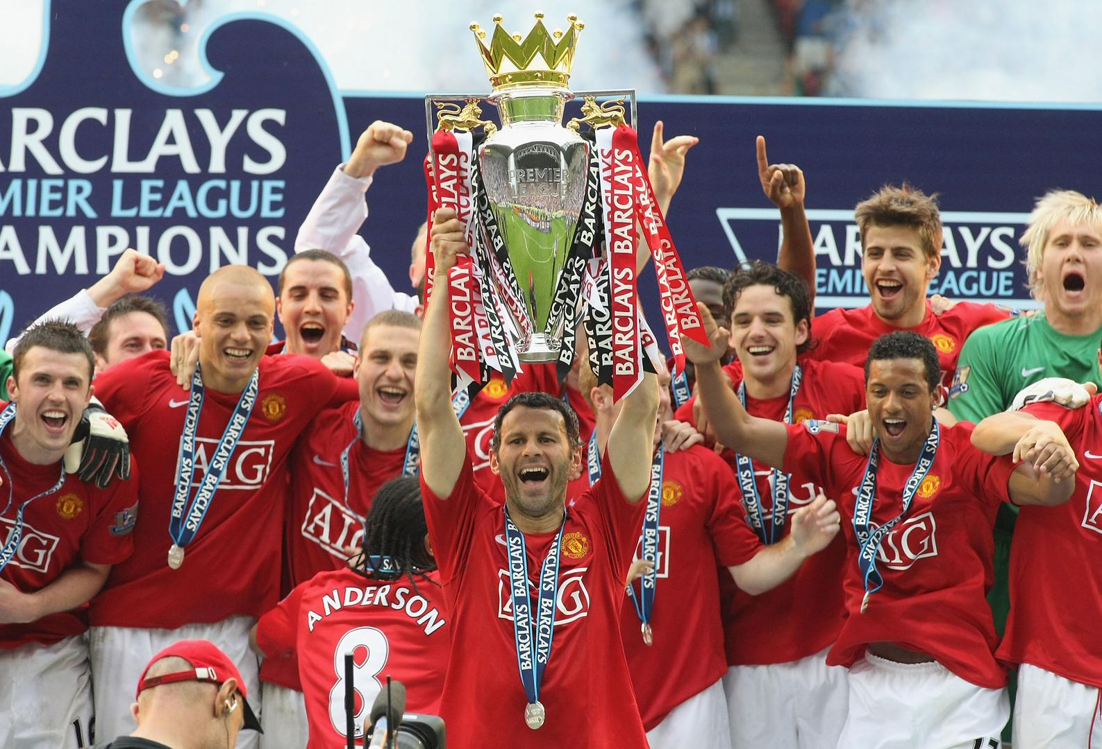 Ryan Giggs lifts the Premier League trophy