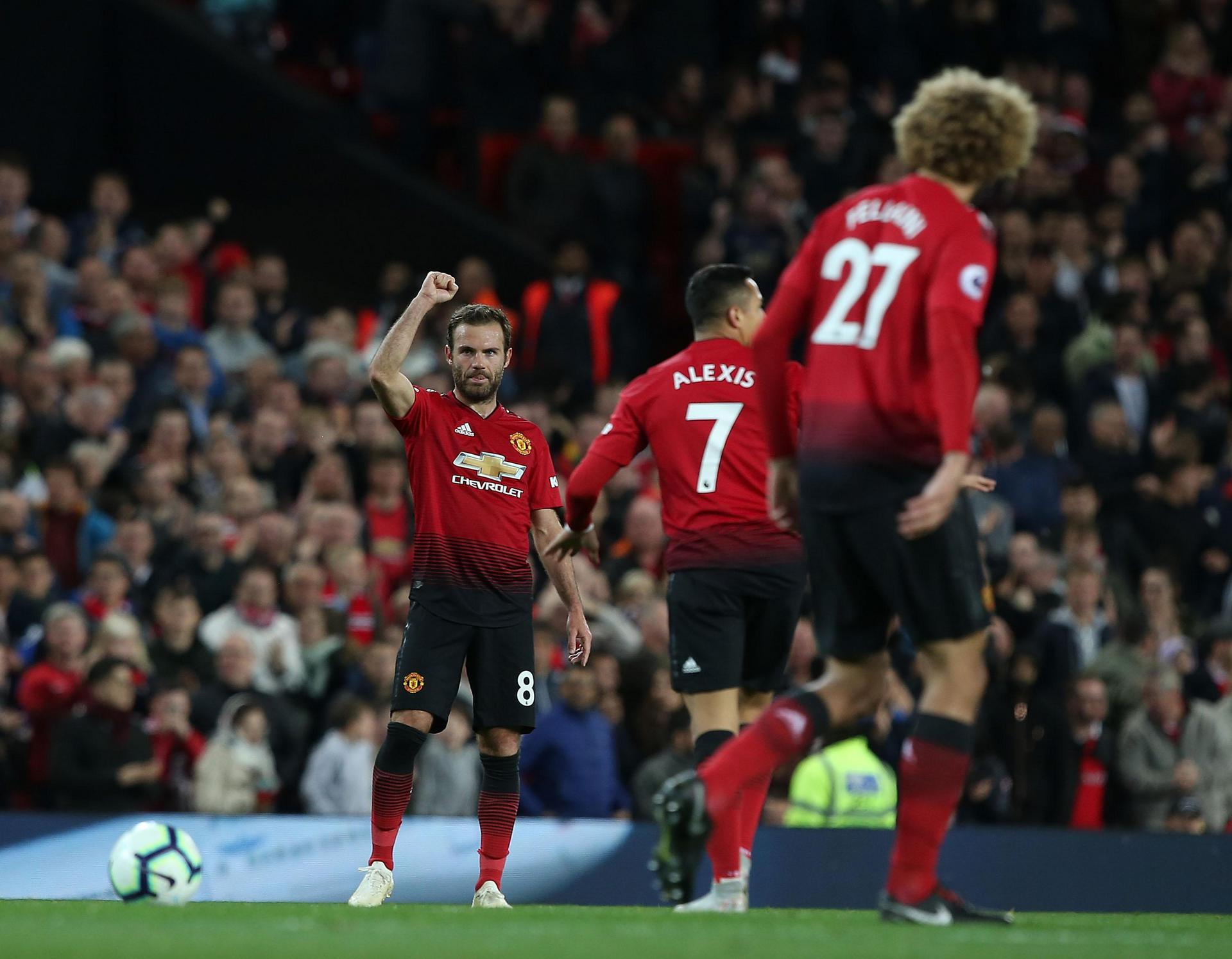 Juan Mata celebrates after scoring against Newcastle