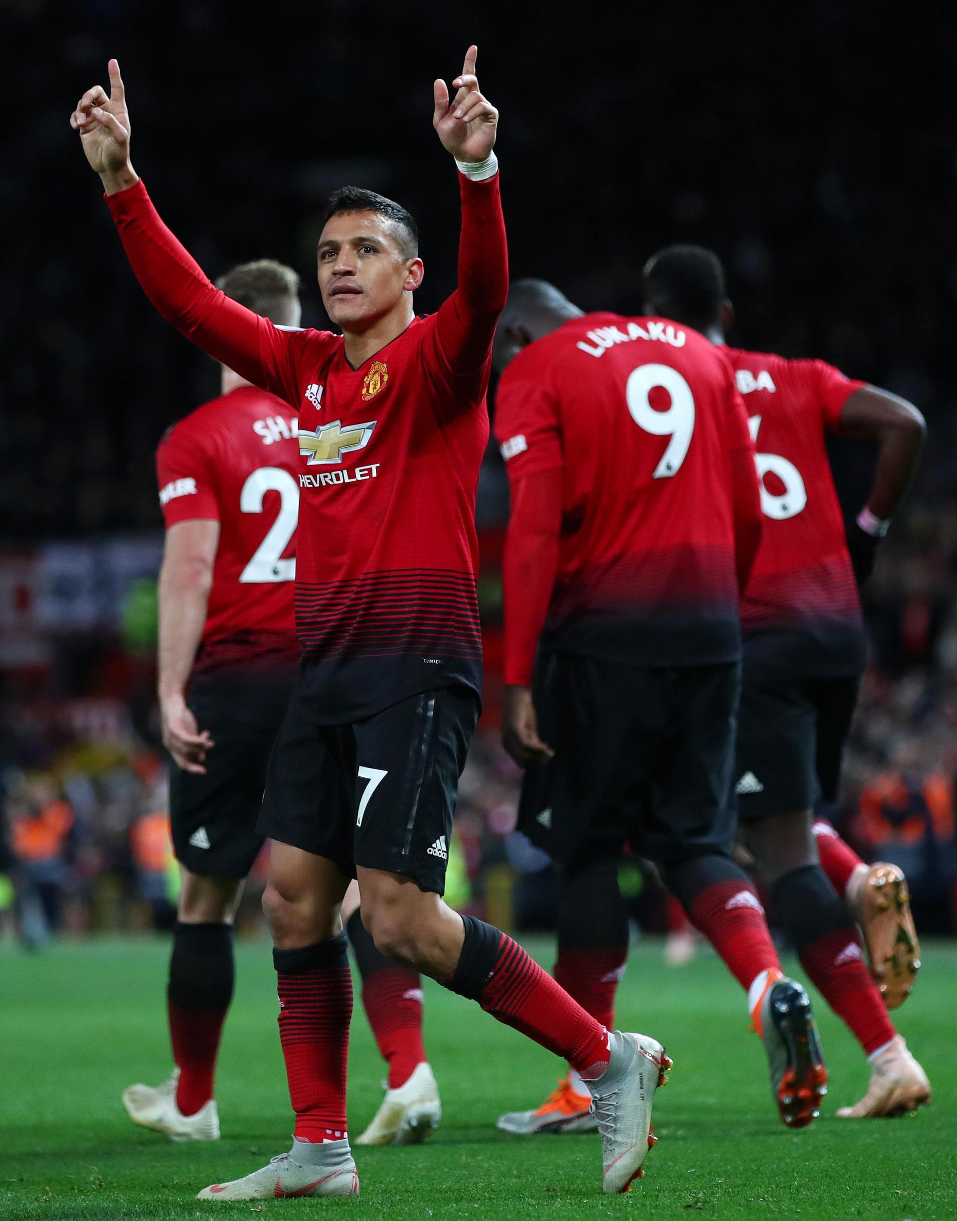 Alexis Sanchez celebrates after scoring the winning goal against Newcastle United