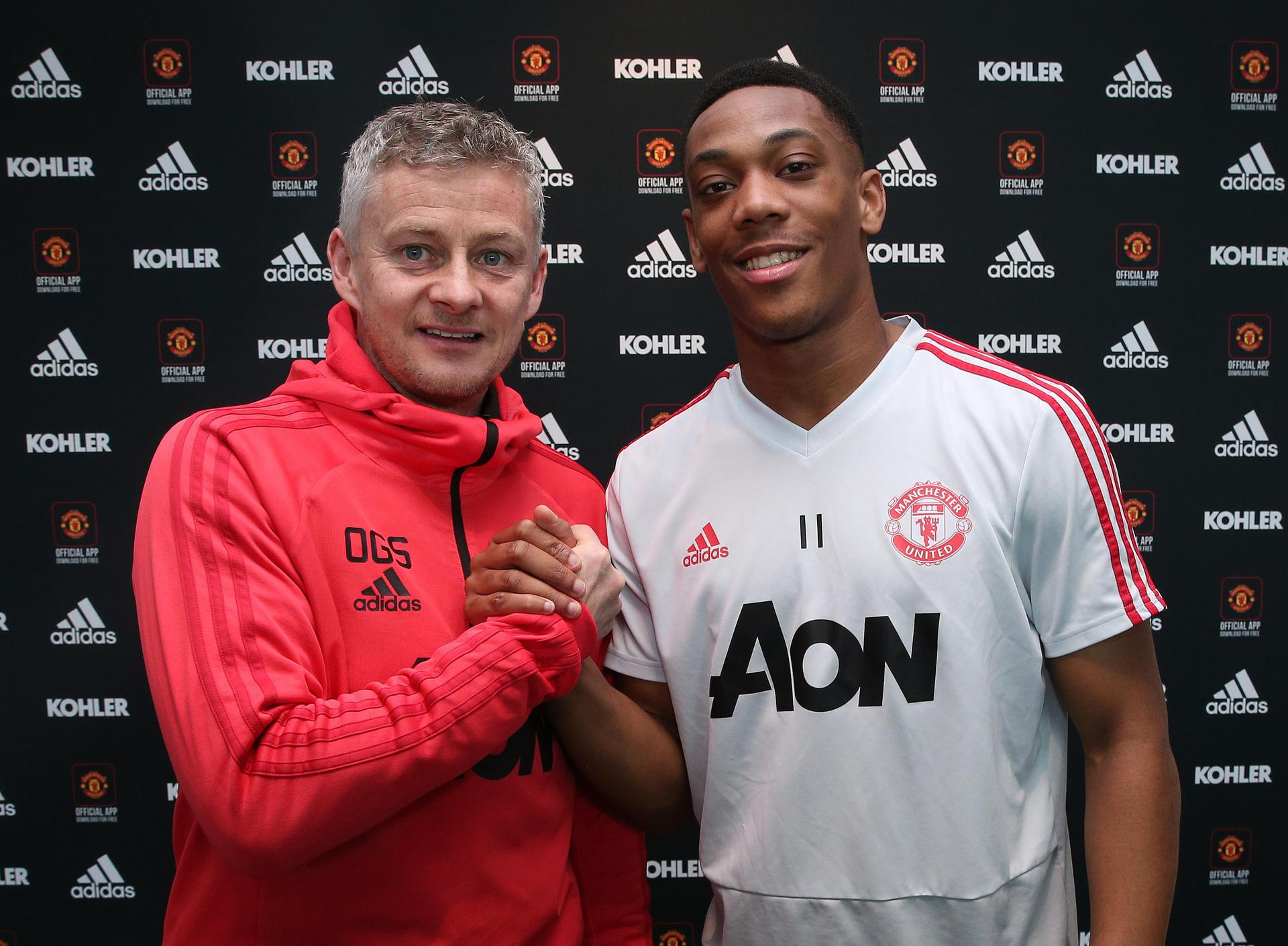 Anthony Martial signing a new contract at United.