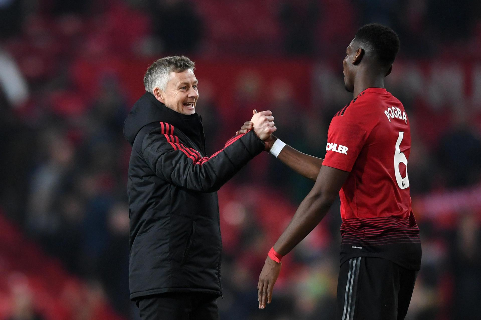 Ole Gunnar Solskjaer and Paul Pogba.