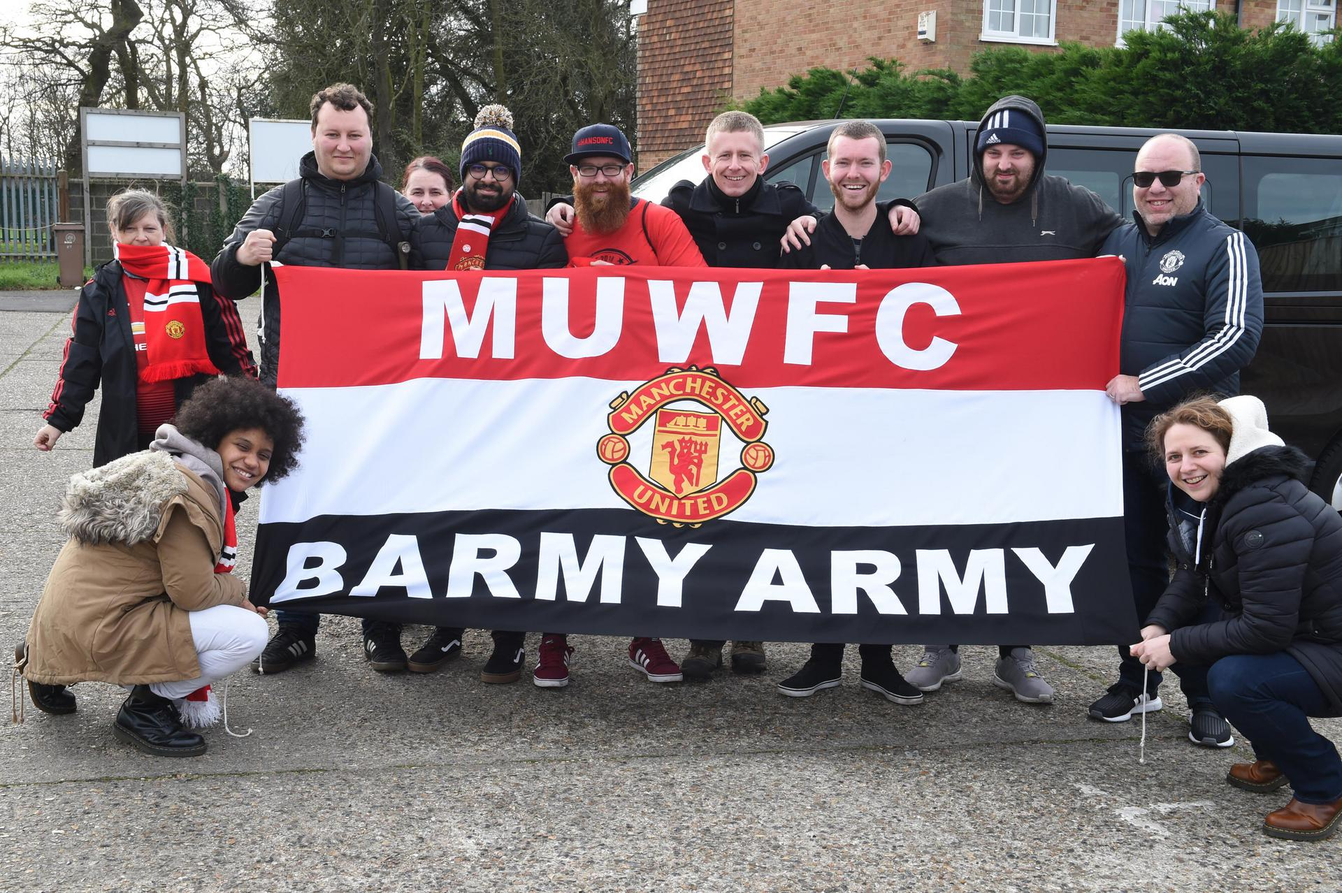 Group of United Women fans with the Barmy Army banner ahead of Charlton game