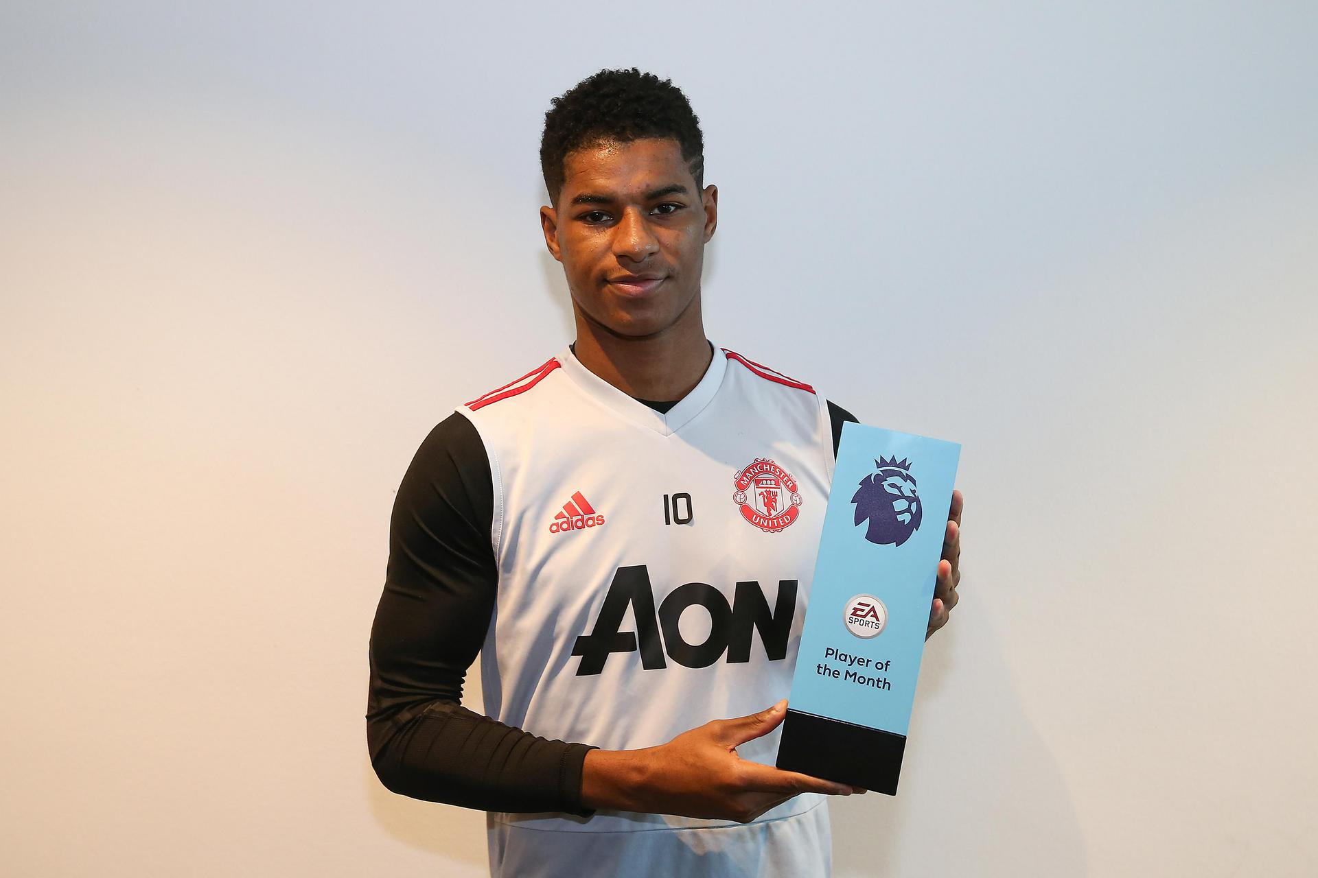 Marcus Rashford with the Premier League Player of the Month award.
