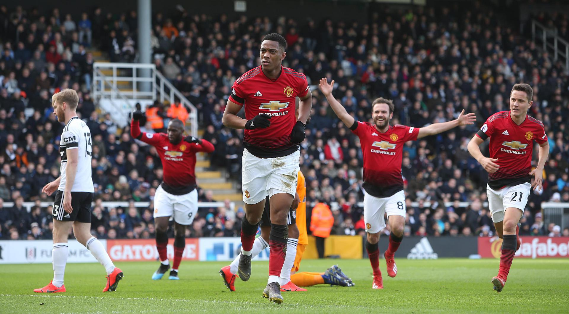 Anthony Martial celebrates his solo goal against Fulham