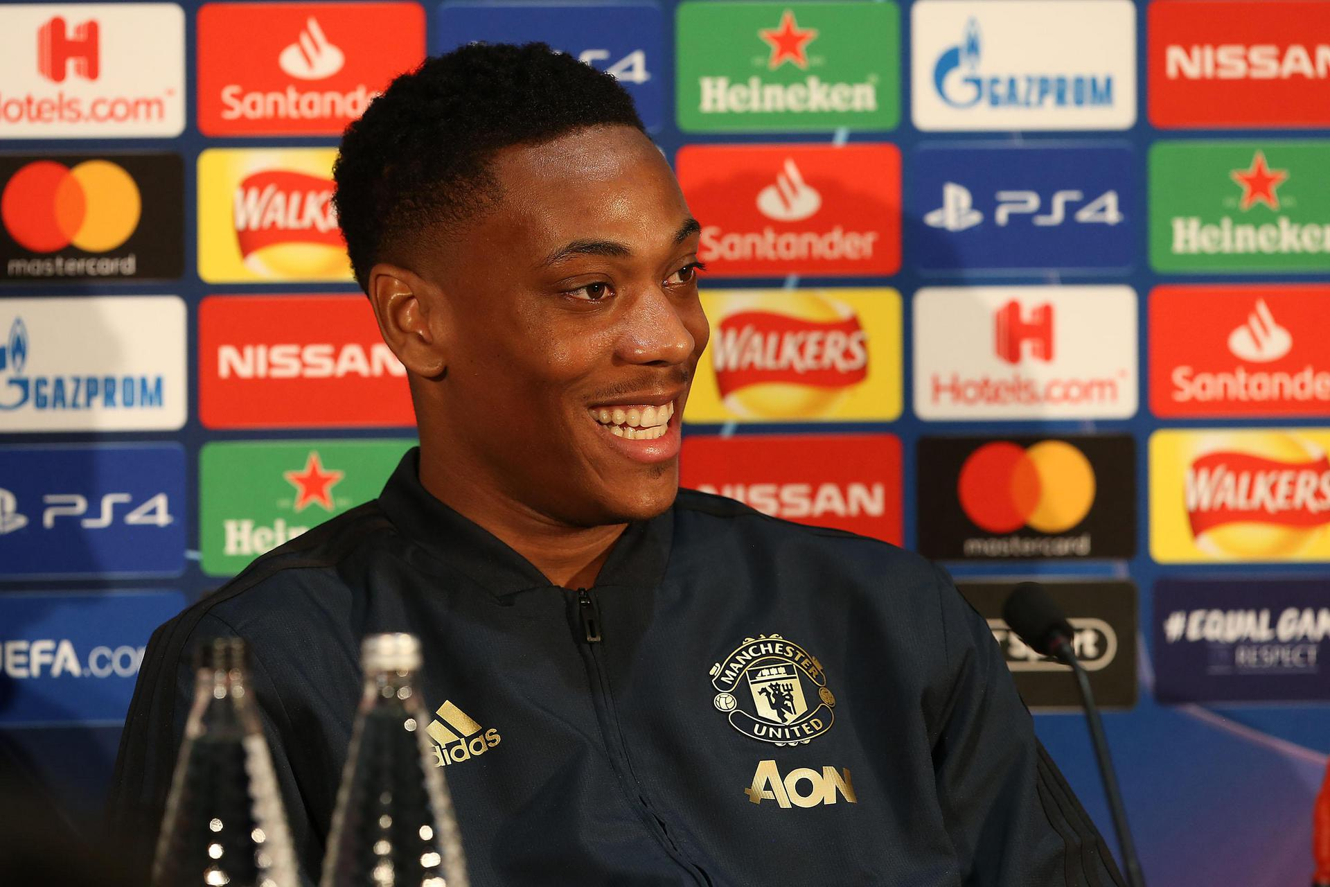 Anthony Martial smiles at a Champions League press conference