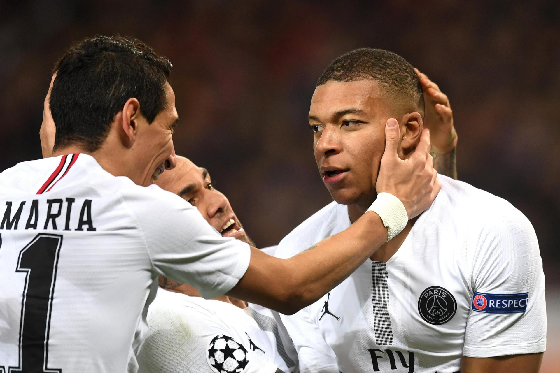 Kylian Mbappe celebrates his goal against United with Angel di Maria.