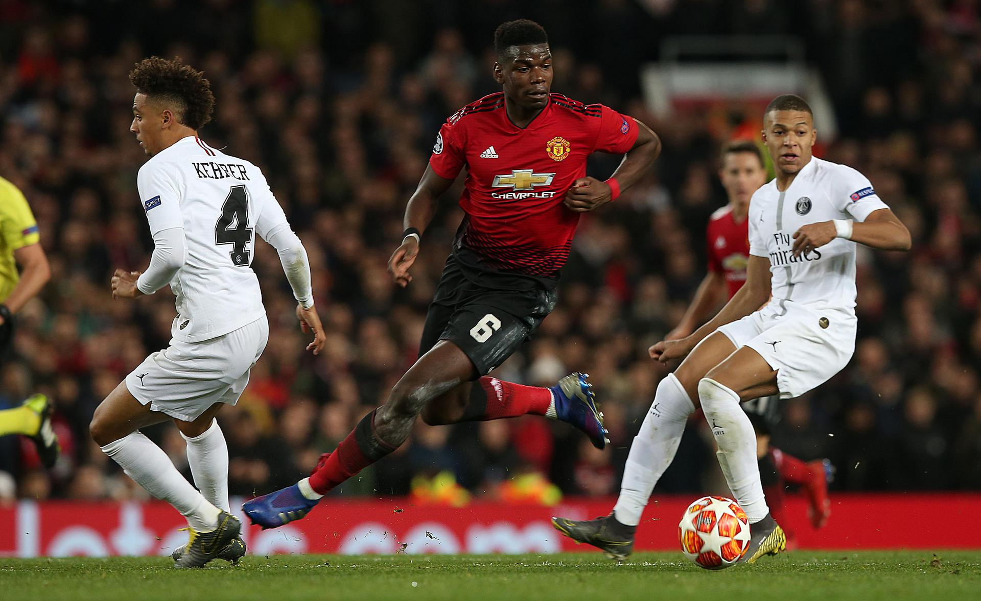 Paul Pogba in action against Kylian Mbappe