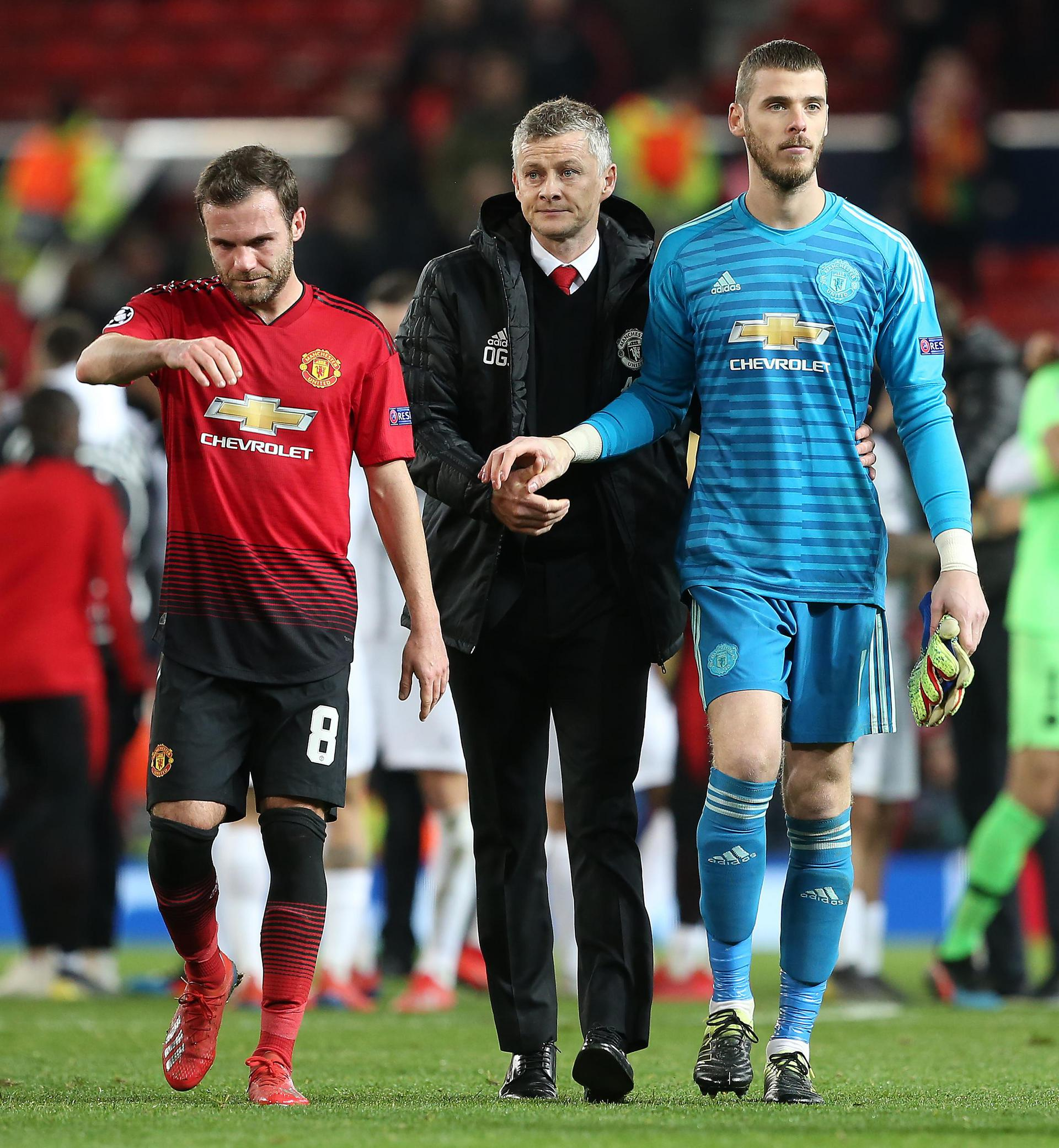 Juan Mata, Ole Gunnar Solskjaer and David De Gea walk off the pitch at full-time in the United v PSG match