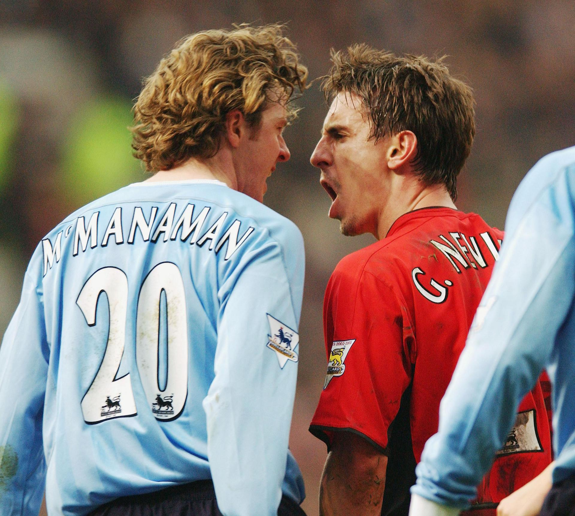 Steve McManaman and Gary Neville clash in the 2004 Manchester derby