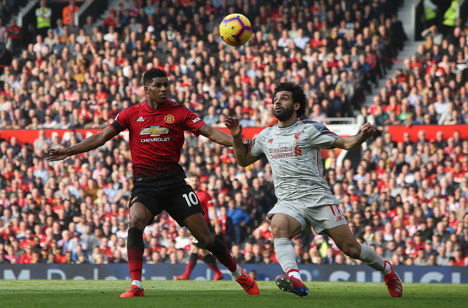 Marcus Rashford and Mohamed Salah battle for the ball during Manchester United's 0-0 draw with Liverpool.