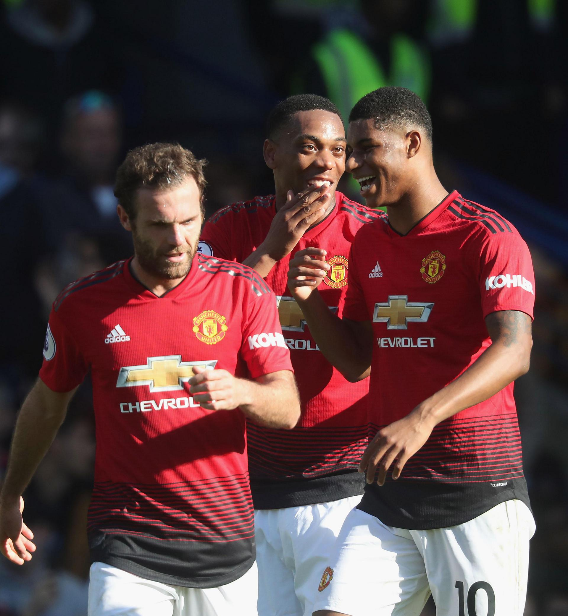 Anthony Martial celebrates a goal against Chelsea with Juan Mata and Marcus Rashford
