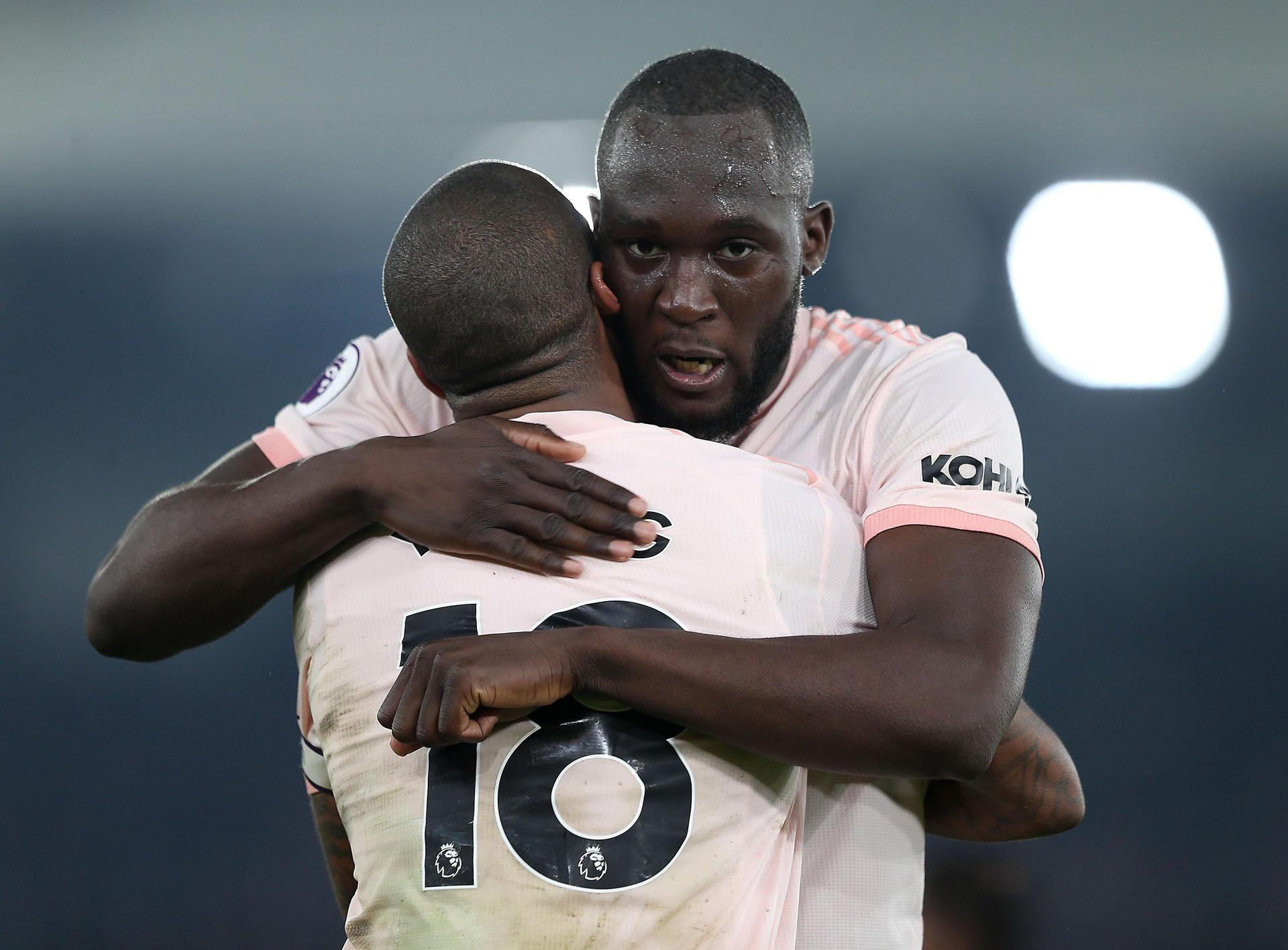 Romelu Lukaku hugs Ashley Young.