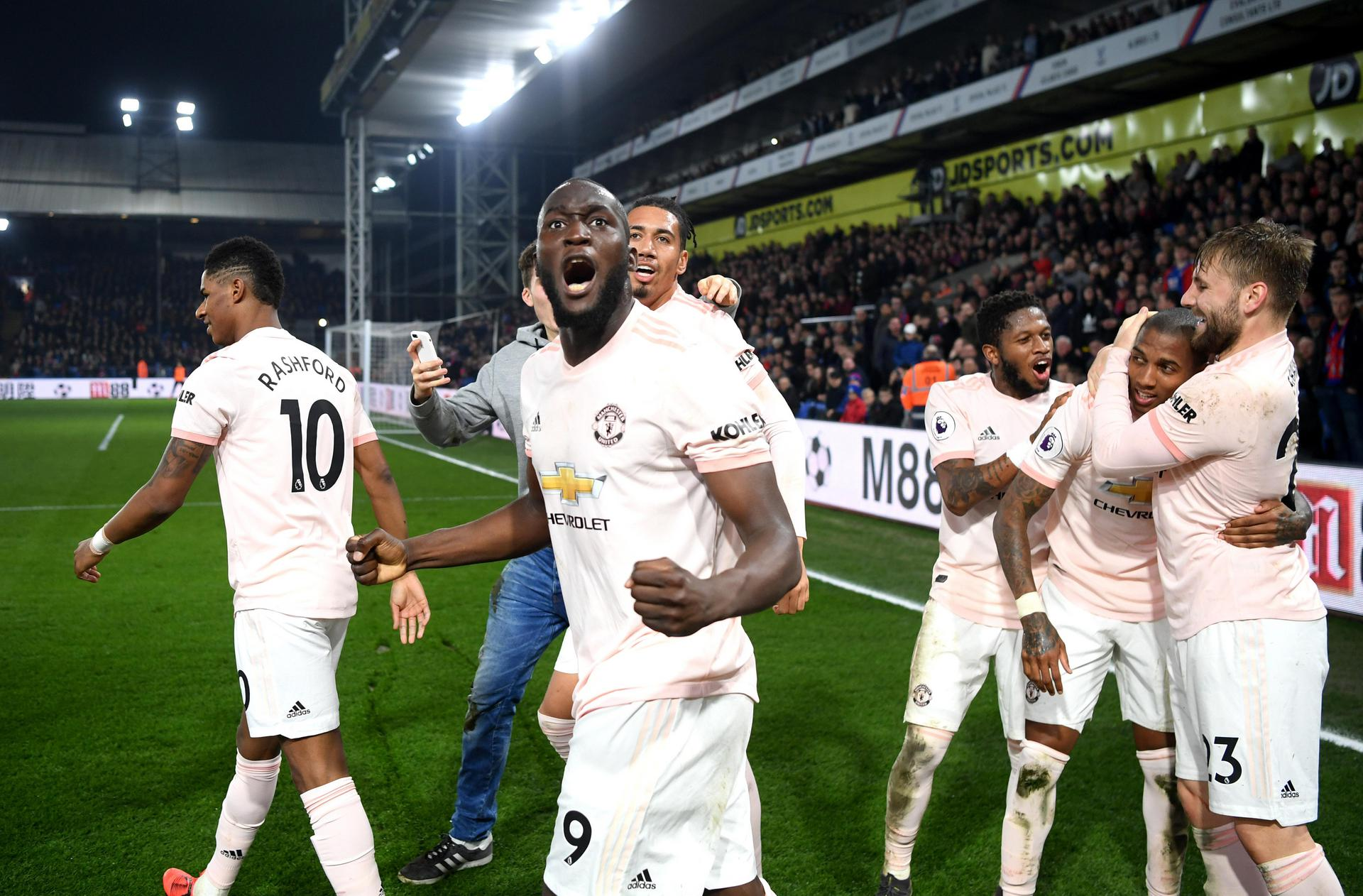 Romelu Lukaku celebrates with his Manchester United team-mates.