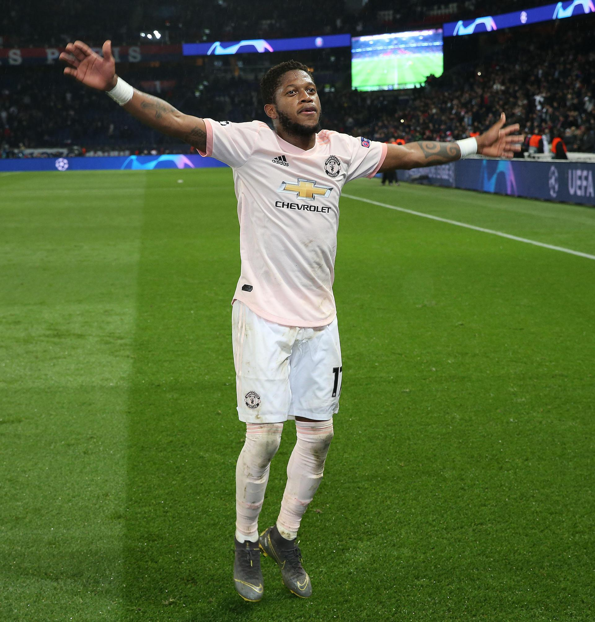 Fred celebrates United's win against PSG.