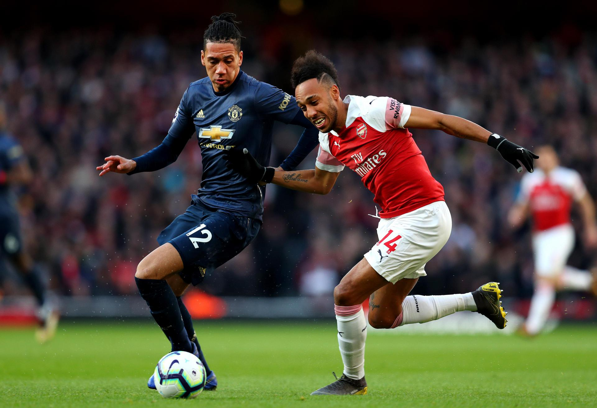 Chris Smalling battles with Pierre-Emerick Aubameyang